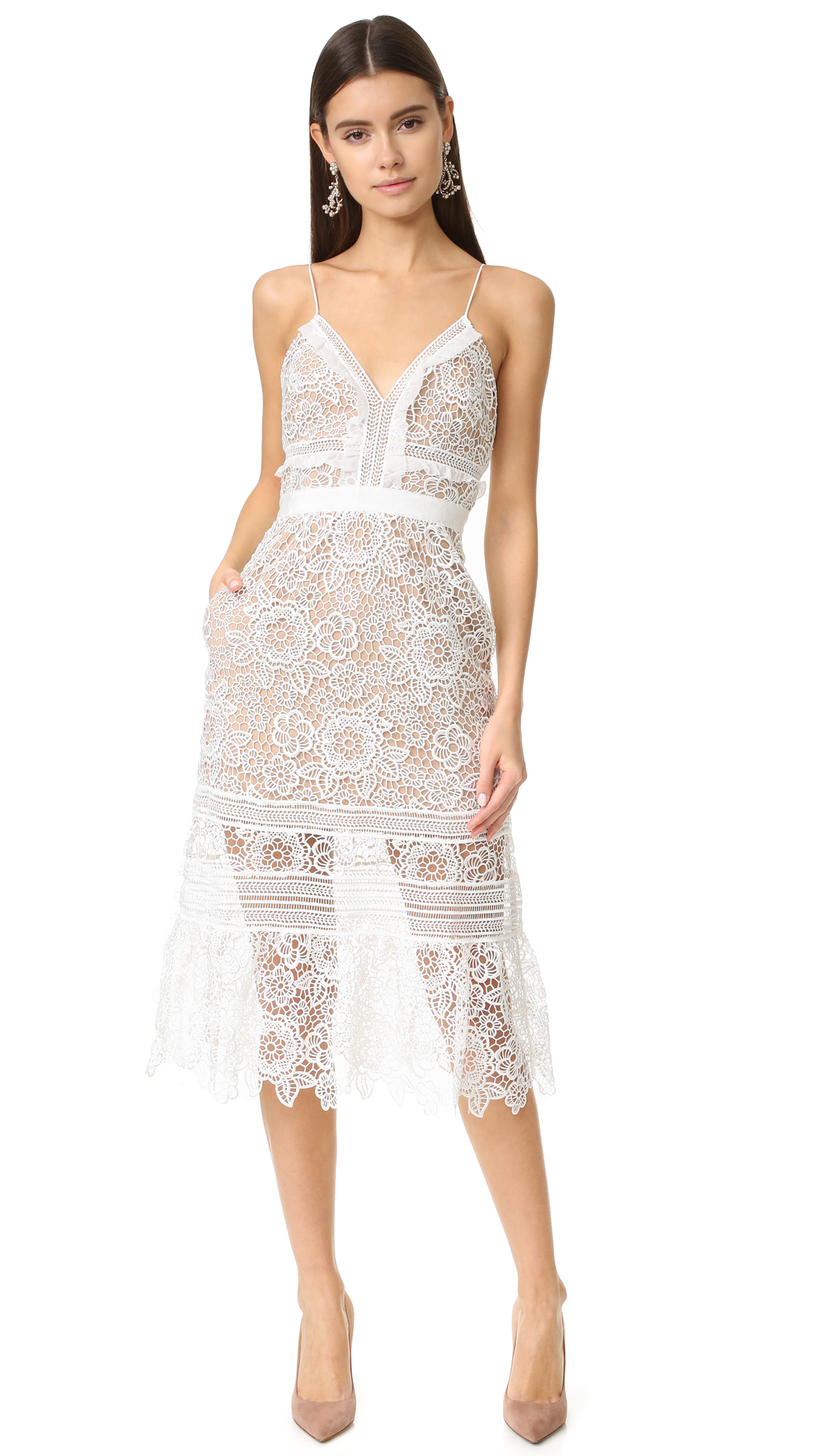 A floral pattern brings romantic, feminine style to this delicate lace Self Portrait midi dress. Crinkled ruffles trim the bodice, and the sheer hem has a graceful, swingy drape. Spaghetti straps. Hidden back zip. Beige lining.