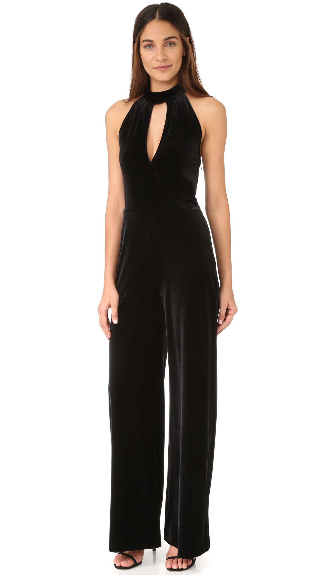 Soft, slinky velour gives this wide leg 7 For All Mankind jumpsuit a luxe, retro inspired feel. Boning structures the sides, and halter straps tie behind the neck. Hidden back zip. Fabric: Velour. 90% polyester/10% spandex. Dry clean.