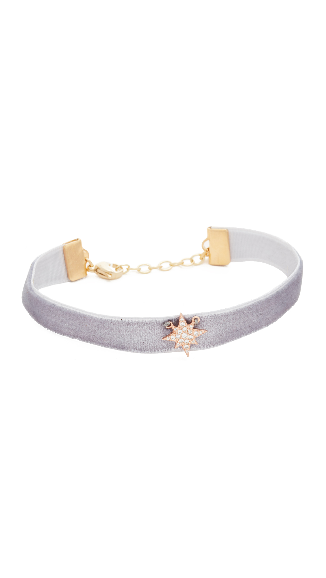 This delicate Shashi bracelet is made from rich velvet and trimmed with a pavé cubic zirconia studded star charm. Lobster claw clasp. Adjustable length. Made in the USA. Measurements Width: 0.5in / 1cm Length: 7in / 18cm. Available