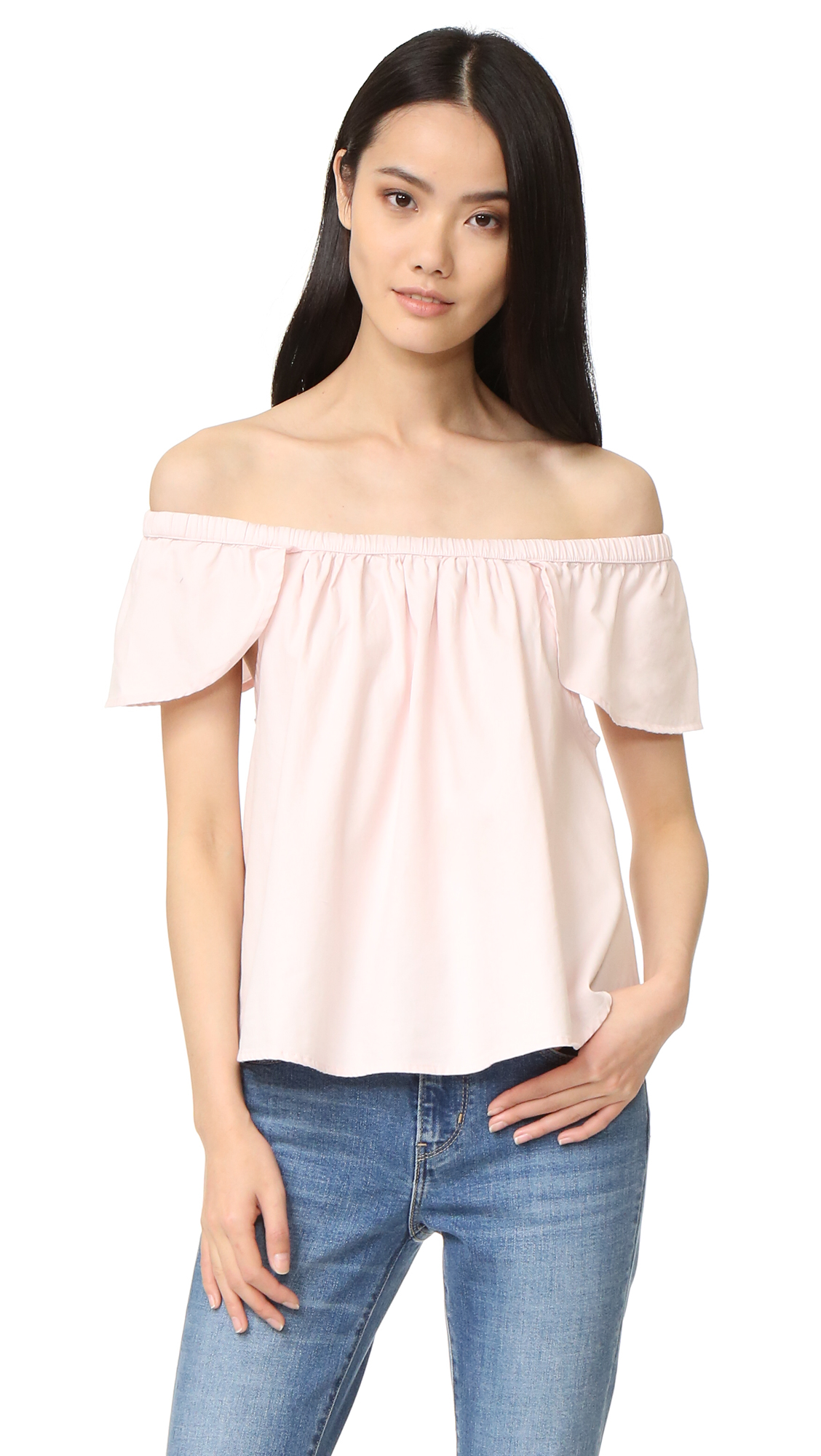 An off shoulder Sincerely Jules blouse with flounced flutter sleeves. Fabric: Plain weave. 100% cotton. Wash cold or dry clean. Imported, Turkey. Measurements Length: 16.25in / 41cm, from center back Measurements from size S. Available sizes: L,M,