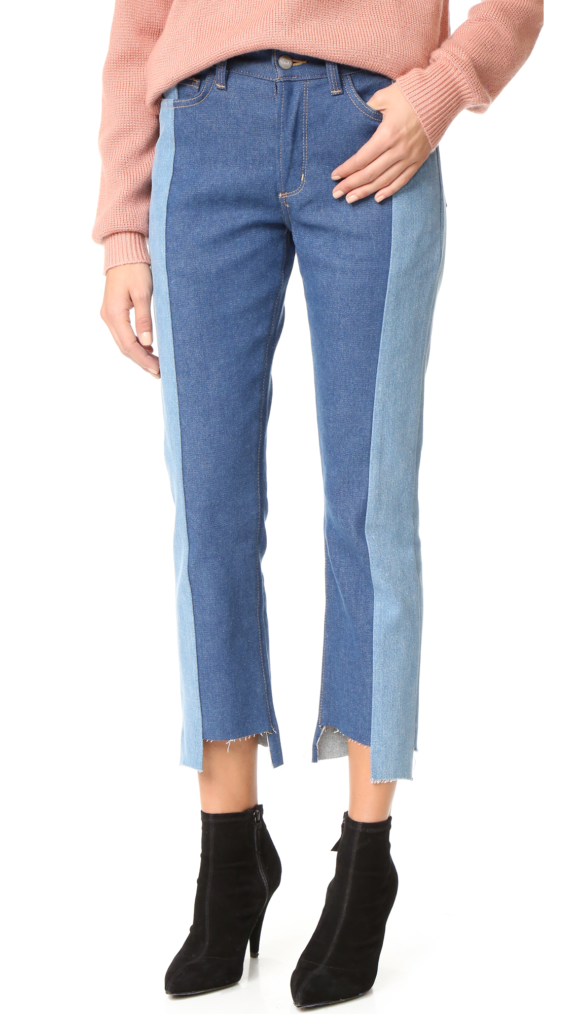A raw, uneven hem adds an undone feel to these two tone, cropped Siwy jeans. 5 pocket styling and button fly. Fabric: Denim. 95.5% cotton/3% polyester/1.5% elastane. 60% cotton/40% lyocell. Wash cold. Made in the USA. Imported components. Measurements