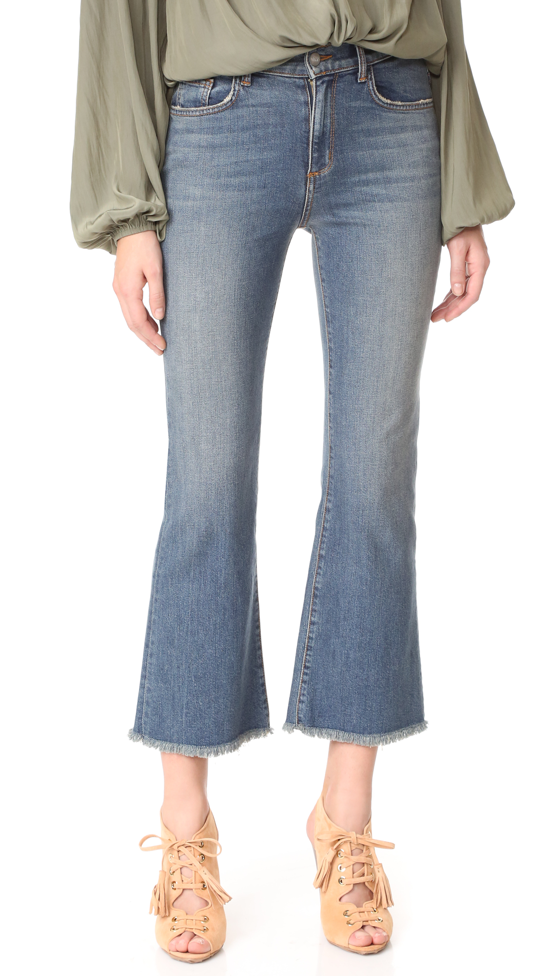 Faded, cropped Siwy flare jeans with frayed cuffs. 5 pocket styling. Button closure and zip fly. Fabric: Stretch denim. 51% cotton/43% lyocell/4% polyester/2% elastane. Wash warm or dry clean. Made in the USA. Imported materials. Measurements Rise: 9.75in / 25