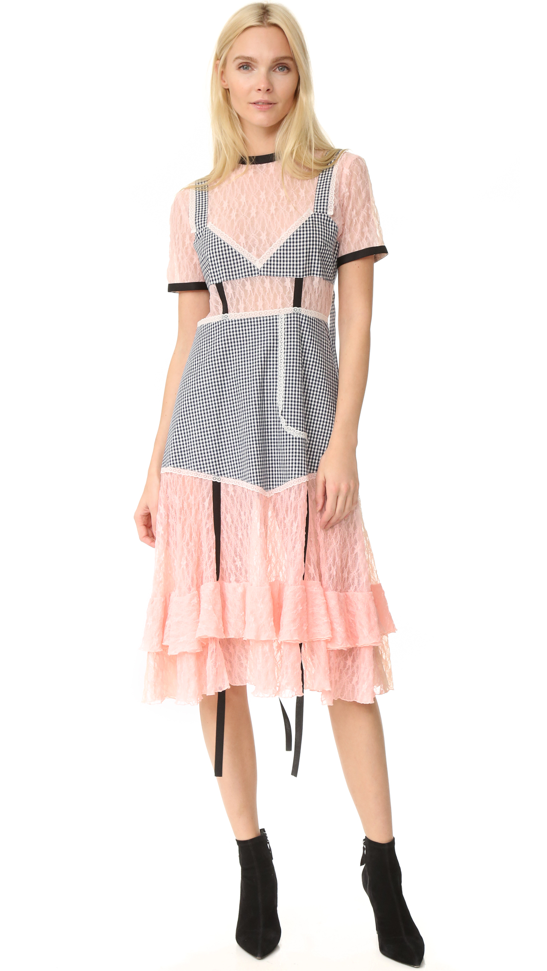 A mixed media Sandy Liang dress with gingham panels over sheer, two tone lace. Contrast fine ribbed banding at the crew neckline and arm openings. Concealed back zip. Unlined. Fabric: Lace / plain weave. Shell: 97% cotton/3% elastane.