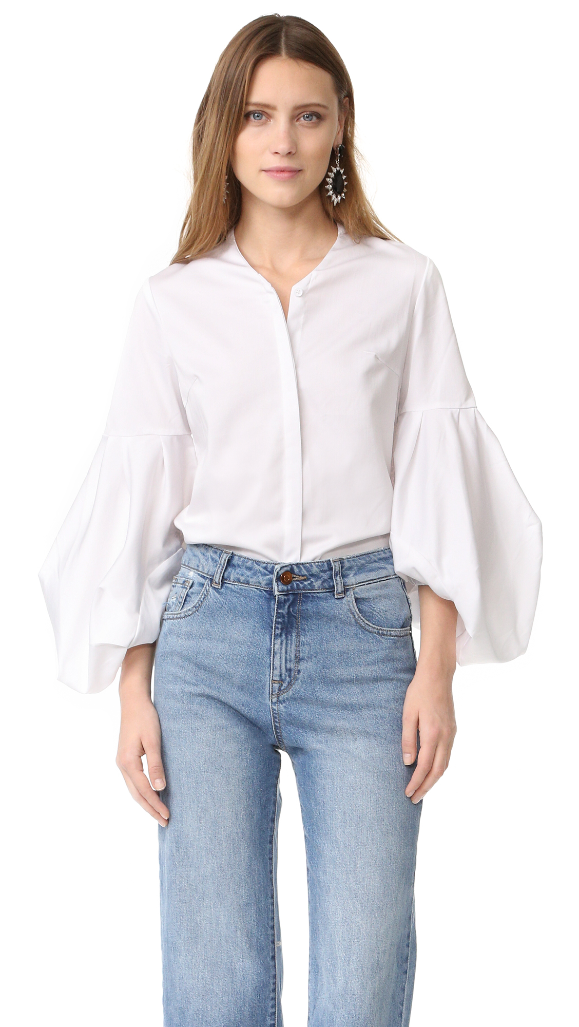 A daring Style Mafia top with drawstring cuffs at the long poet sleeves. V neckline and concealed button placket. Fabric: Plain weave. 65% cotton/32% nylon/3% polyurethane. Wash cold. Imported, China. Measurements Length: 25.5in / 64.5cm, from shoulder Measurements