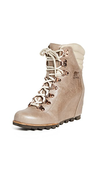 Sorel Conquest Wedge Holiday Booties In Beach/Fawn