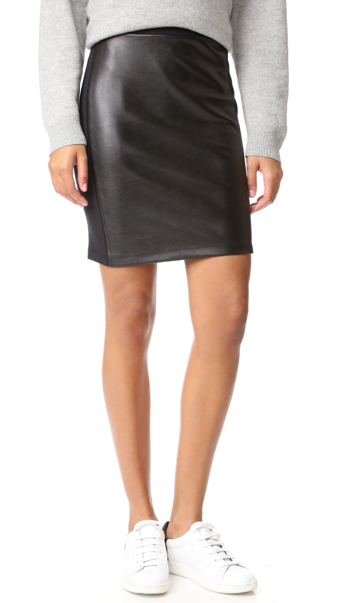 A faux leather front panel adds a sophisticated edge to this french terry Splendid skirt. Covered elastic waistband. Vented hem. Unlined. Fabric: Faux leather / french terry. Shell: 48% cotton/48% modal/4% spandex. Trim: 100% polyurethane. Dry clean. Made in