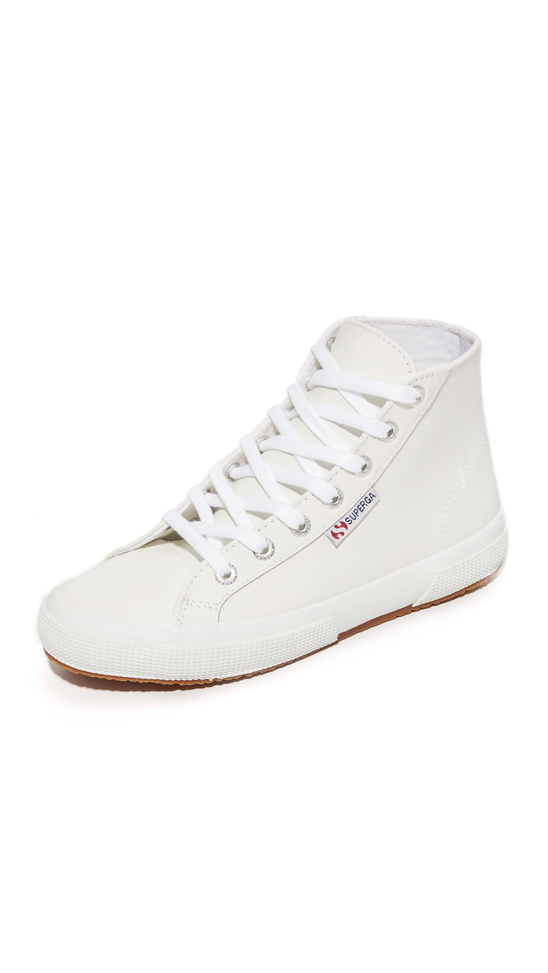 Casual Superga high top sneakers rendered in sturdy leather. Laces thread through logo embossed grommets. Rubber sidewall and crepe sole. Leather: Cowhide. Imported, Vietnam. This item cannot be gift boxed. Available sizes: 6,6.5,7,7.5,8,8.5,9,9.5,10