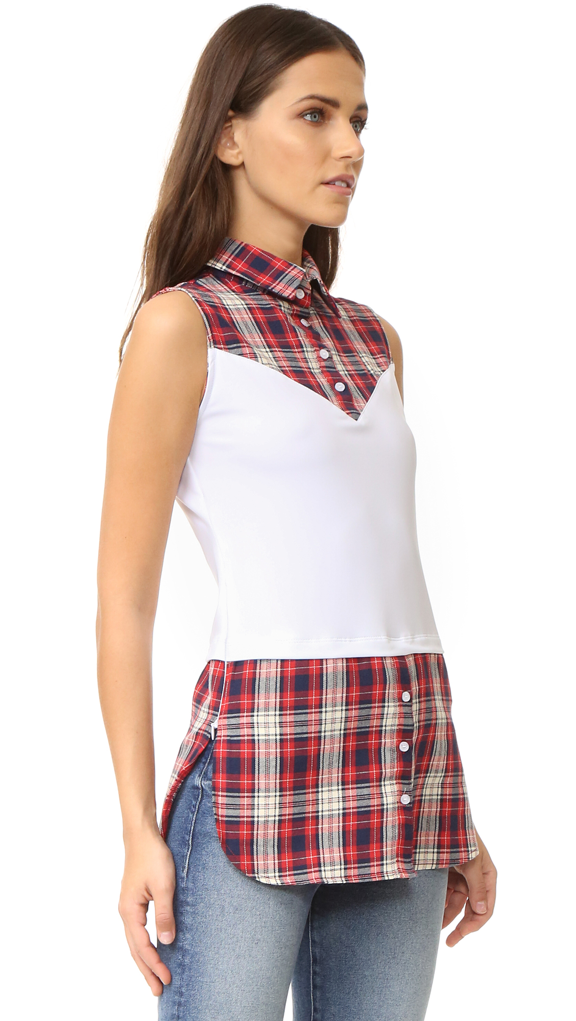 Crisp, plaid shirting forms the angular yoke and shirttail hem of this formfitting SKINNYSHIRT top. The easy to layer piece is inset with a panel of slinky jersey for an effortless fit. Partial button placket. Covered