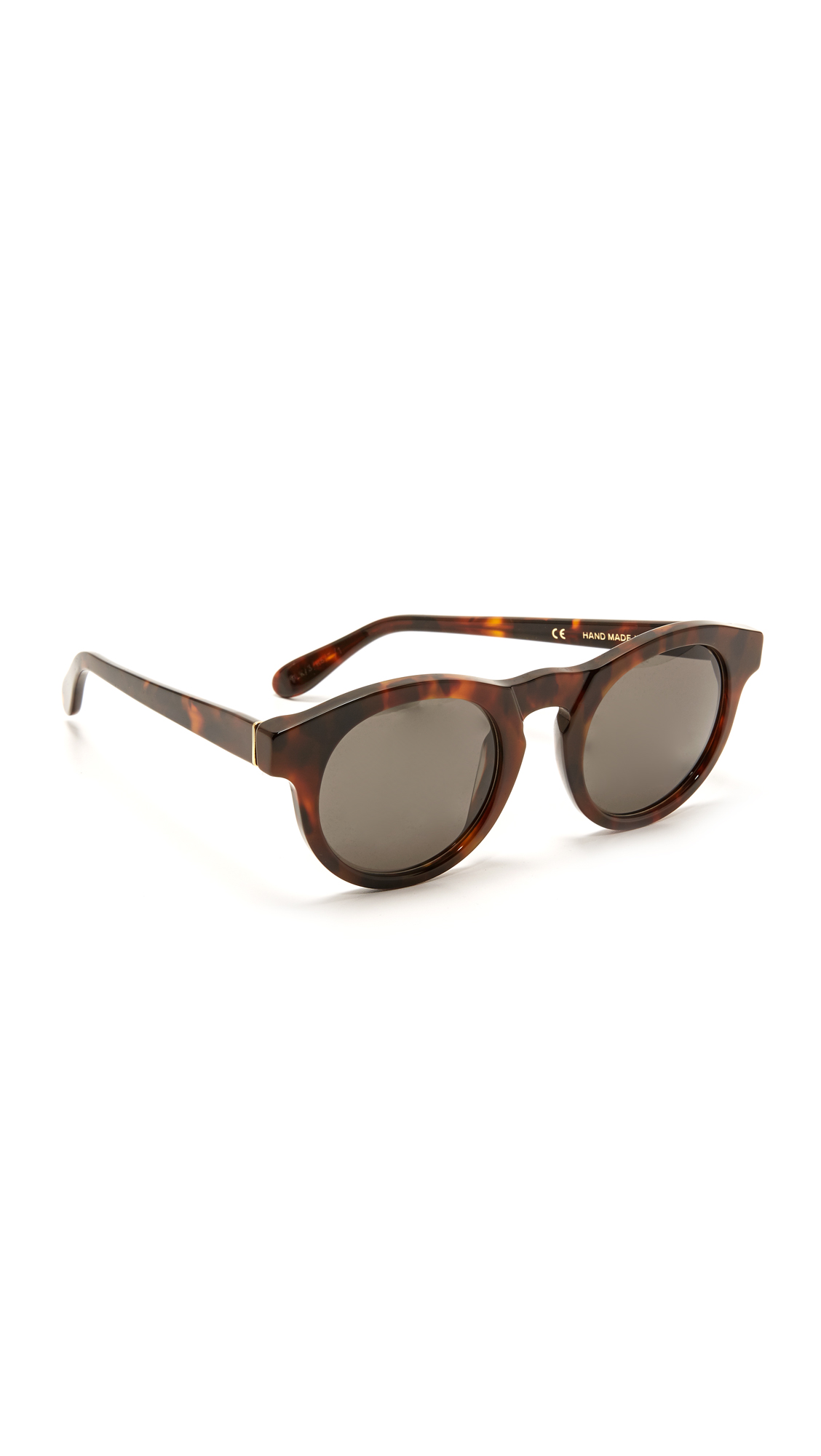 Chunky tortoiseshell Super Sunglasses with glossy frames and tinted lenses. Cleaning cloth and pouch included. Round frame. Non polarized lenses. Made in Italy. Measurements Width: 5.75in / 14.5cm Height: 2in / 5cm Lens Width: 50mm. Available sizes: One