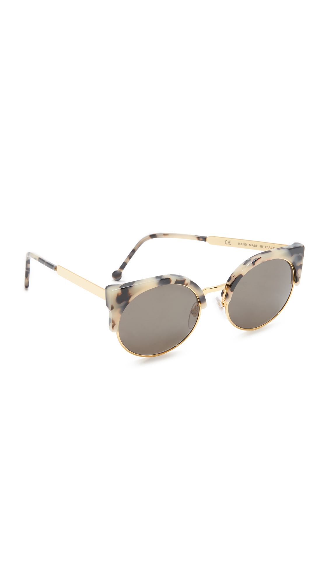 Retro inspired Super Sunglasses in a mix of polished metal and tortoiseshell acetate. Case and cleaning cloth included. Semi rimless frame. Non polarized lenses. Made in Italy. Measurements Width: 5.25in / 13.5cm Height: 2in / 5cm Lens Width: 55