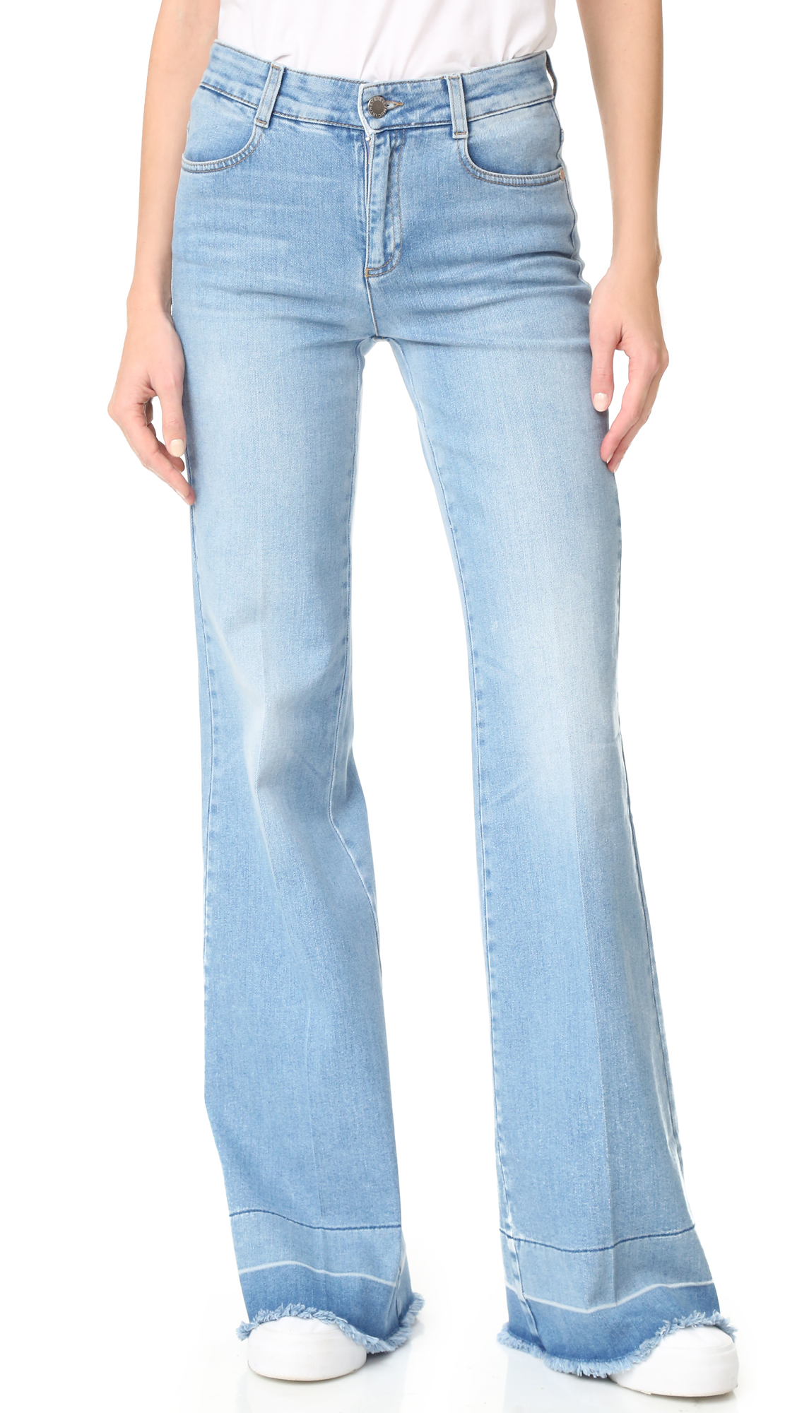 Runs small. Please see Size & Fit tab. Raw, undone hems lend a deconstructed element to these faded Stella McCartney jeans. 4 pocket styling. Button closure and zip fly. Fabric: Stretch denim. 92% cotton/6% elastomultiester/2% elastane. Wash cold. Made