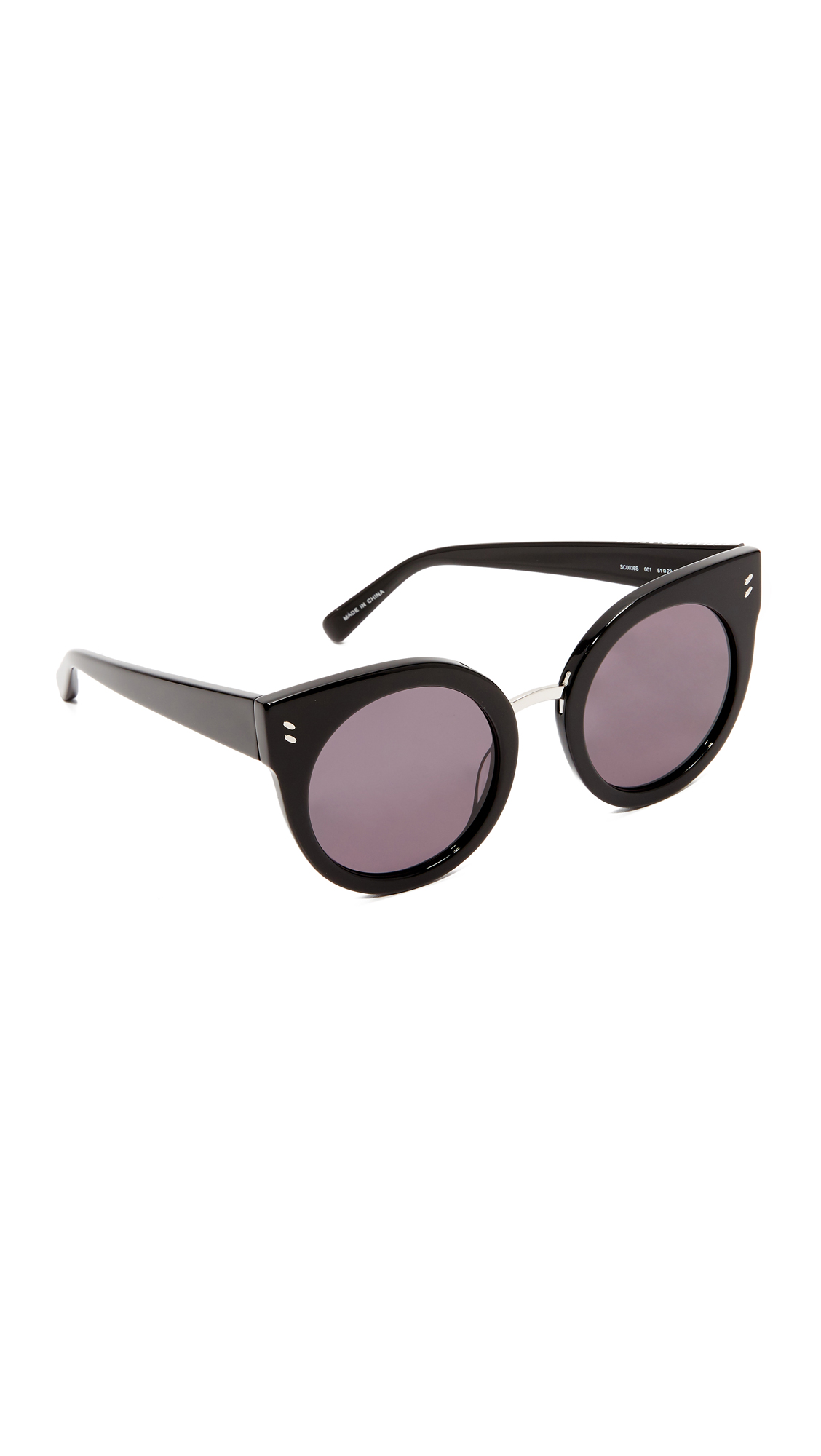 Bold Stella McCartney cat eye sunglasses with thick, glossy frames and a metal accent at the bridge. Soft pouch and cleaning cloth included. Cateye frame. Non polarized lenses. Imported, China. Measurements Width: 5.5in / 14cm Height: 2.25in / 5.5