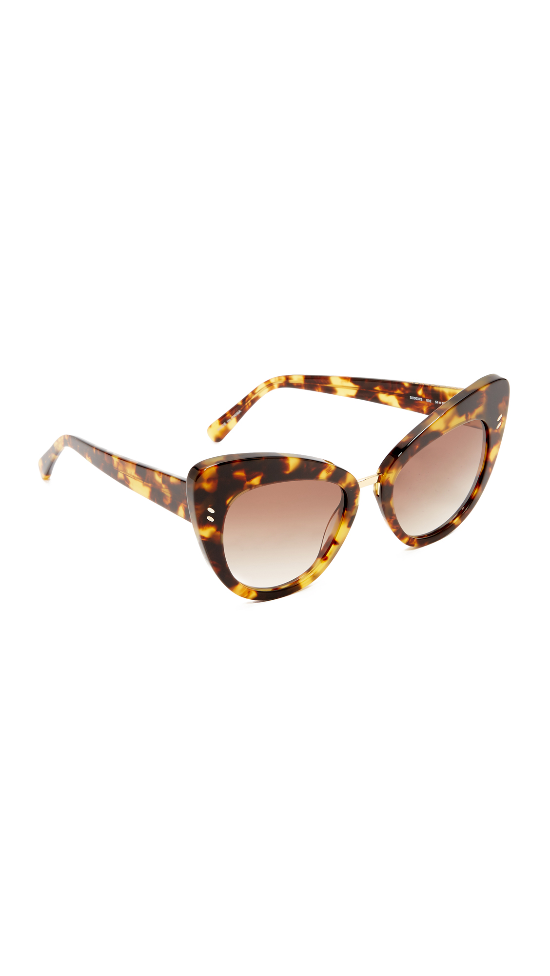 Stylish Stella McCartney cat eye sunglasses with thick, glossy frames and a metal accent at the bridge. Soft pouch and cleaning cloth included. Cateye frame. Non polarized lenses. Imported, China. Measurements Width: 6in / 15cm Height: 2.25in / 5.5