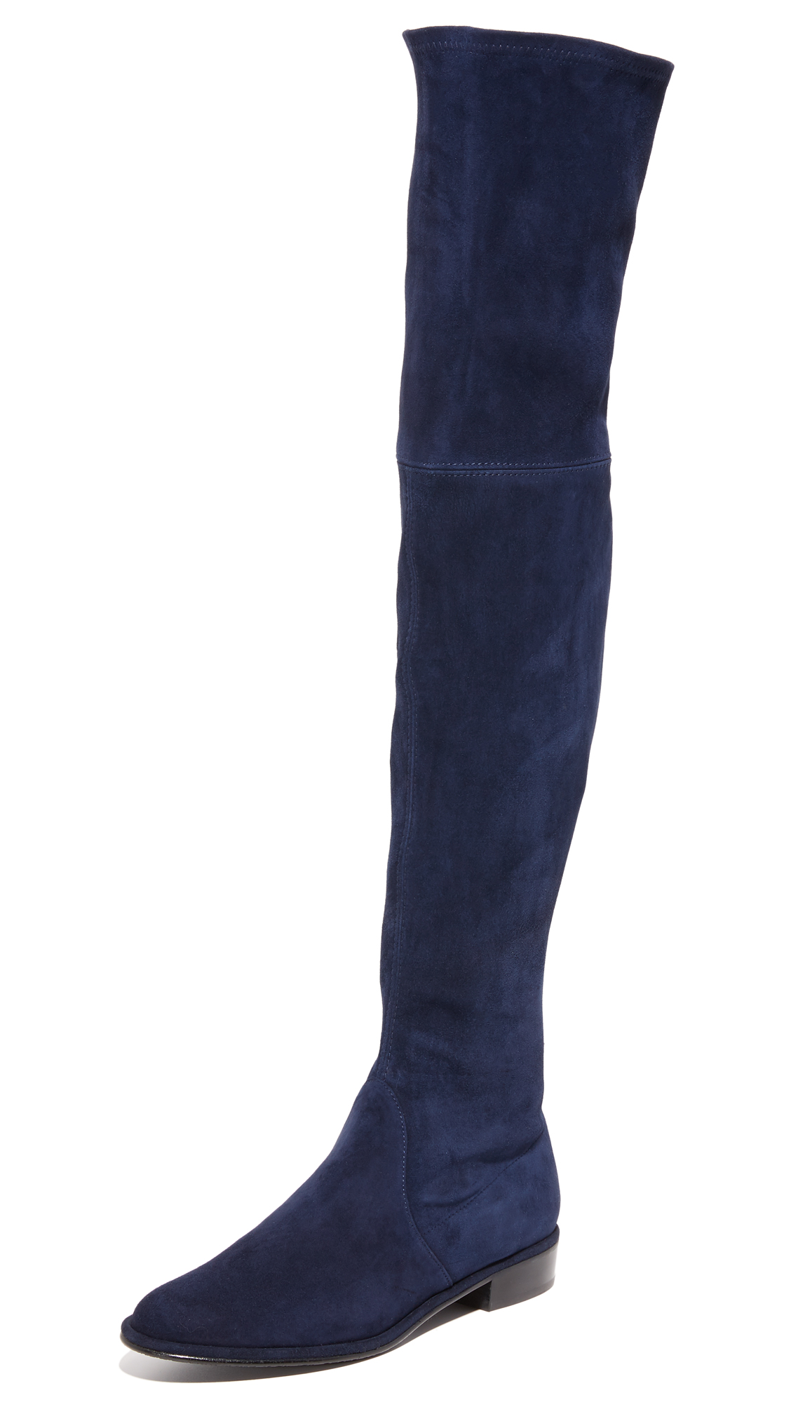 Over the knee Stuart Weitzman boots in luxe, stretch suede. Decorative exposed zipper at the back. Stacked heel and rubber sole. Leather: Cowhide. Made in Spain. This item cannot be gift boxed. Measurements Heel: 0.75in / 20mm
