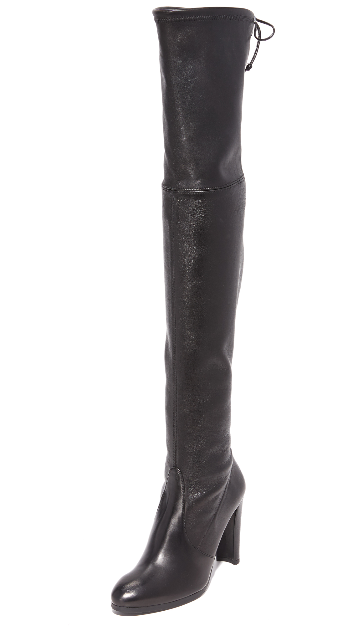 Stretch leather lends a close, comfortable fit to slim Stuart Weitzman over the knee boots. A suede drawstring cinches the top line. Covered heel and rubber sole. Leather: Cowhide. Made in Italy. This item cannot be