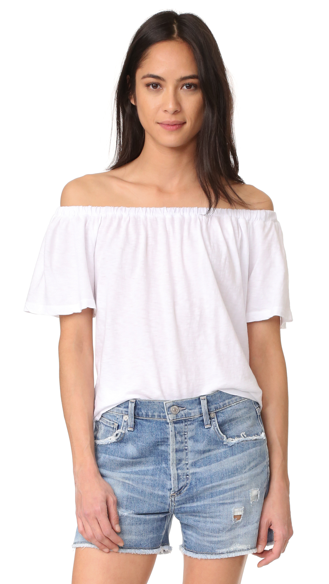 Covered elastic cinches the off shoulder neckline on this breezy SUNDRY tee. Short flutter sleeves. Fabric: Jersey. 100% cotton. Wash cold. Made in the USA. Measurements Length: 18.5in / 47cm, from center back Measurements from size 1. Available sizes: 0,1,2,3