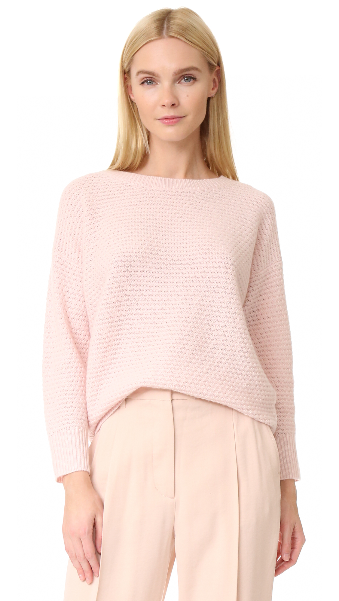 A plush Claudia Schiffer x TSE Cashmere sweater with light texture throughout. Crew neckline. Long sleeves. Fabric: Soft knit. 100% cashmere. Dry clean. Imported, China. Measurements Length: 24.75in / 63cm, from shoulder Measurements from size S. Available sizes:
