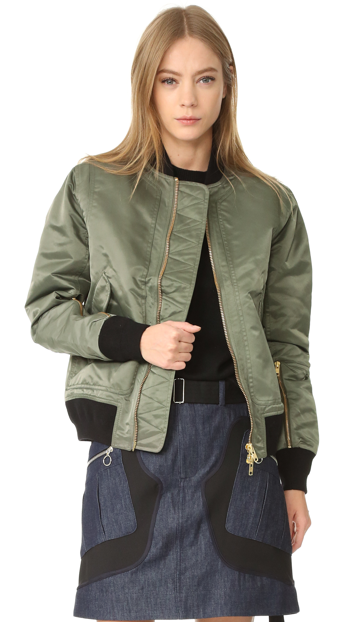 A utilitarian Tim Coppens bomber jacket with lustrous sheen. Flap pockets border the 2 way zip placket, and zip pockets detail the long sleeves. Contrast, ribbed edges. Quilted lining. Fabric: Lustrous technical weave. 100% nylon. Dry clean. Imported,