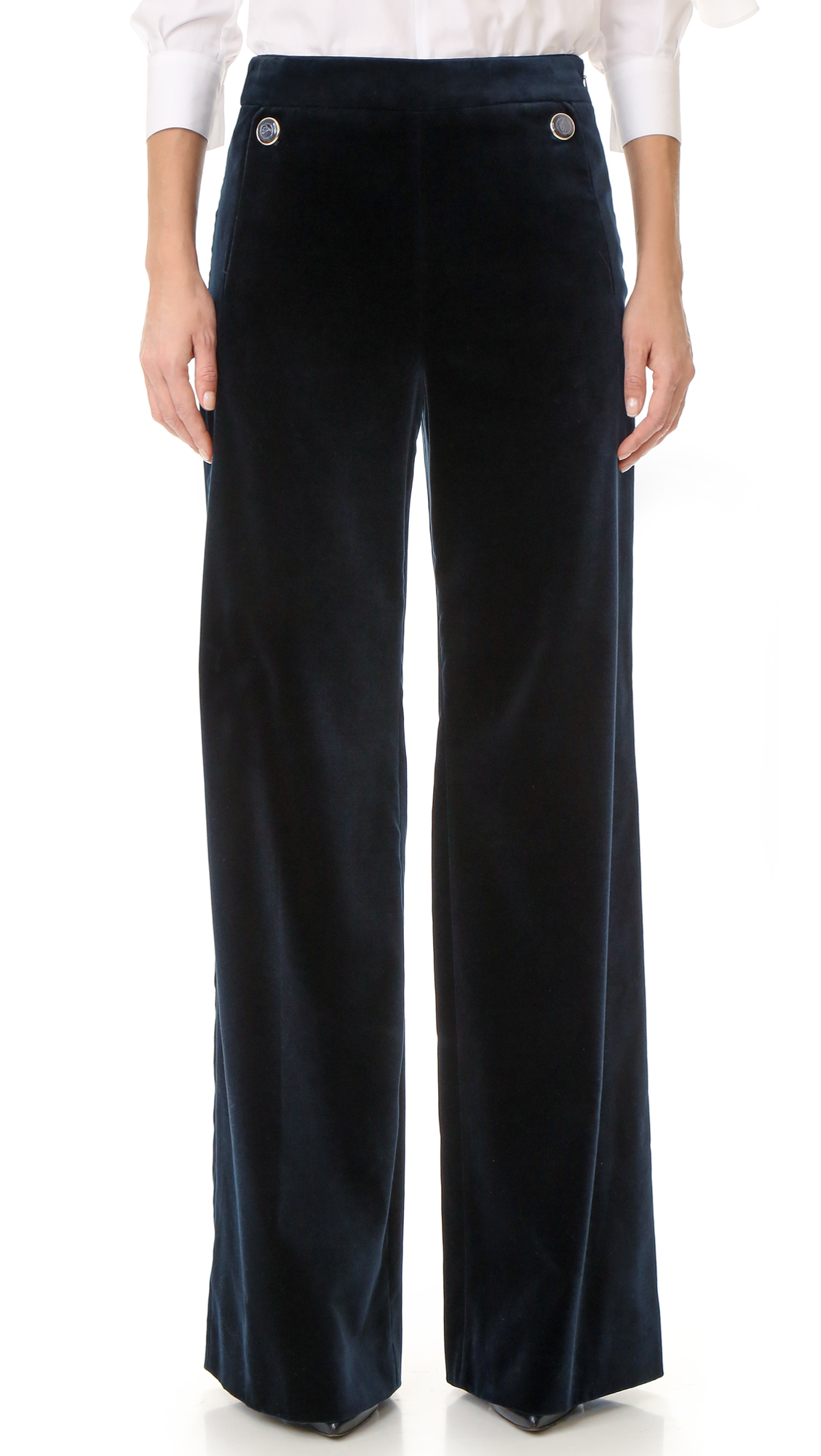 Luxe velvet Temperley London pants in a high waisted, wide leg profile. Enamel inlaid buttons accent the front, and welt pockets detail the back. Hidden side zip. Fabric: Velvet. 70% cotton/28% viscose/2% elastane. Dry clean. Made in