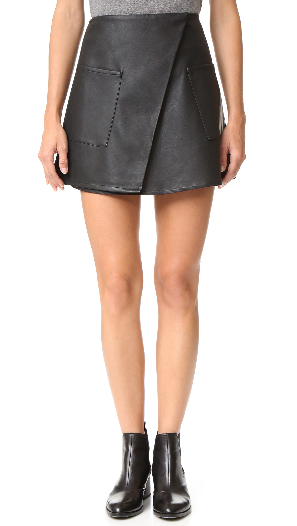 Supple faux leather lends an edgy feel to this classic, A line The Fifth Label wrap skirt. Patch hip pockets. Hook and eye and button closures. Lined. Fabric: Faux leather. Shell: 60% viscose/40% polyurethane. Lining: 100% polyester. Hand