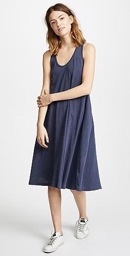 styling a blush lace long sleeve midi dress with a gucci belt