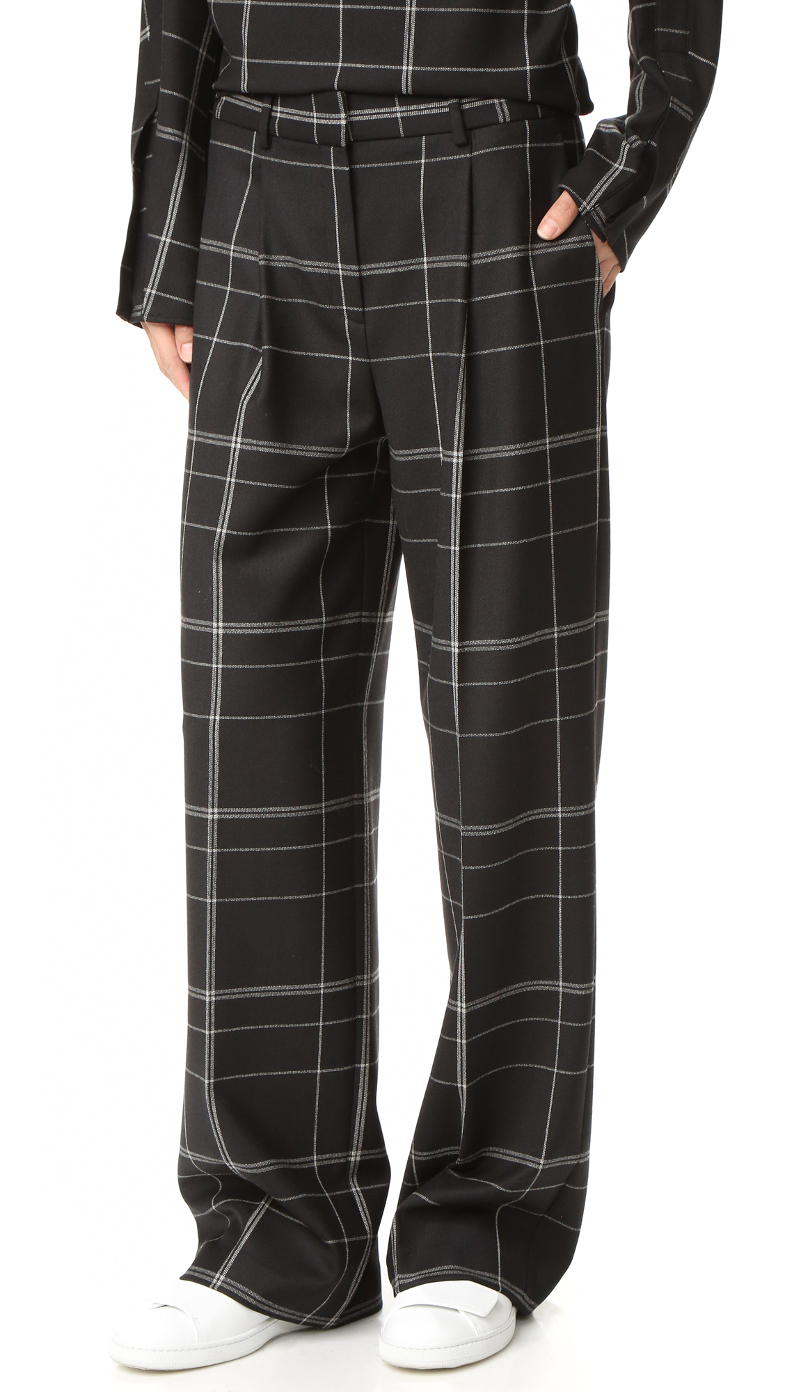 Wide leg Theory pants in a sophisticated check pattern. high waist. Slant front pockets and button welt back pockets. Hook and eye closure and zip fly. Fabric: Suiting. 53% polyester/43% virgin wool/4% elastane. Dry clean. Imported, Vietnam.