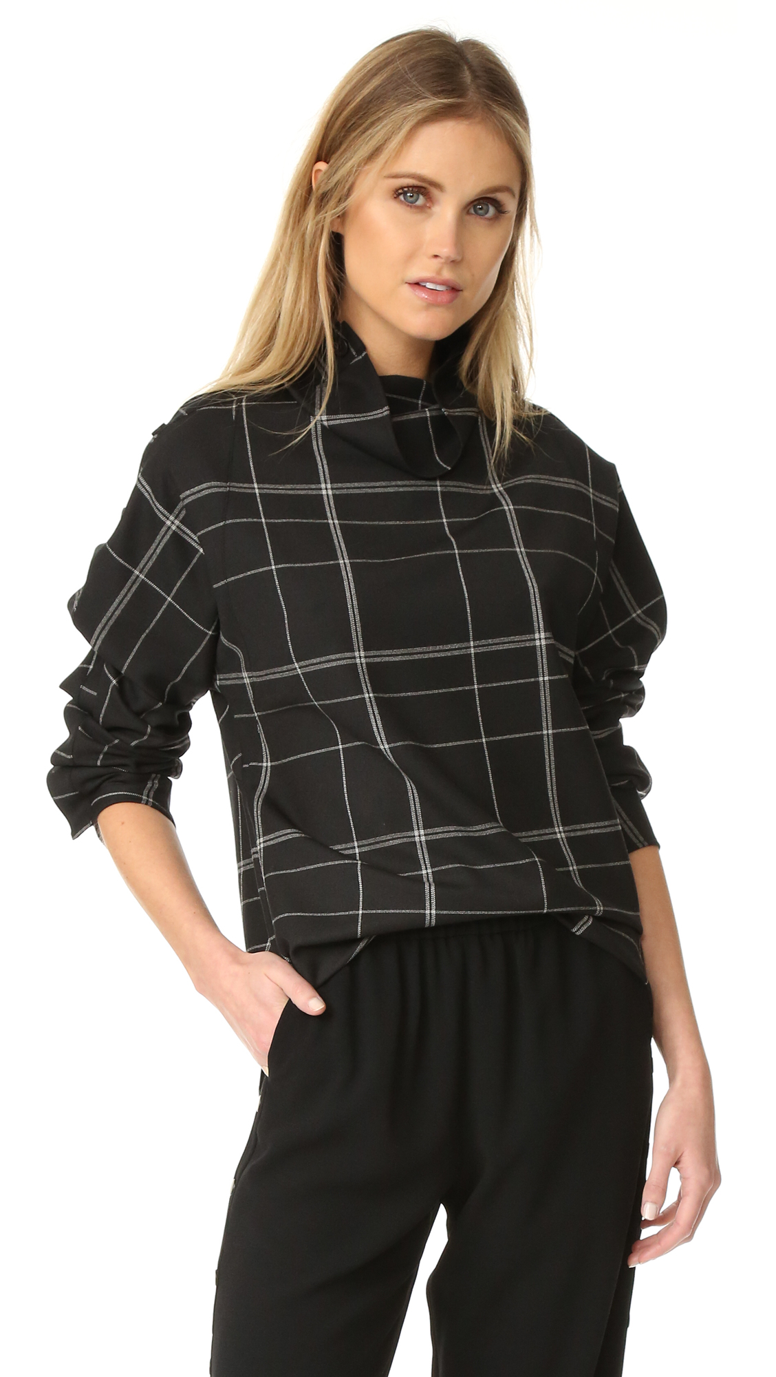 A sophisticated Theory tunic in a neutral check pattern. Buttons extend from the slouchy neckline to the long sleeves. Vented, uneven hem. Fabric: Suiting. 53% polyester/43% polyester/4% elastane. Dry clean. Imported, Vietnam. Measurements Length 1: 28in / 71cm, from