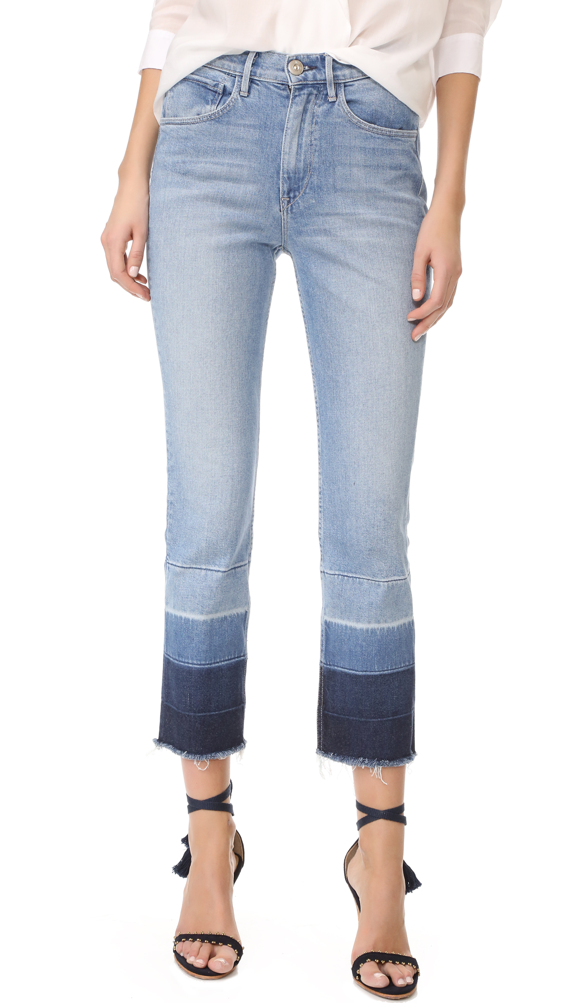 An undone hem adds a worn feel to these cropped 3x1 jeans. 5 pocket styling. Button closure and zip fly. Fabric: Stretch denim. 94% cotton/5% polyester/1% elastane. Hand wash. Made in the USA. Measurements Rise: 10.75in / 27cm Inseam: 26.5