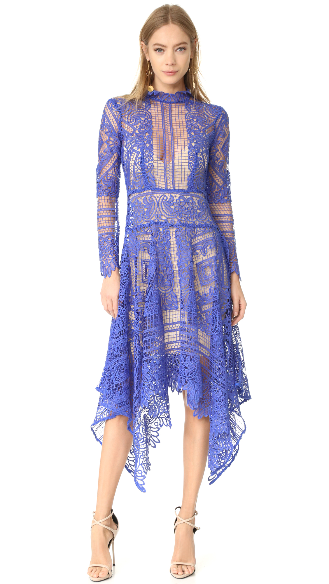 Description NOTE: Sizes listed are Australian. Please see Size & Fit tab. Intricate patterns accent this elegant lace THURLEY dress. The flared skirt and uneven hem create a dramatic, swingy shape. High neckline. Sheer yoke and long