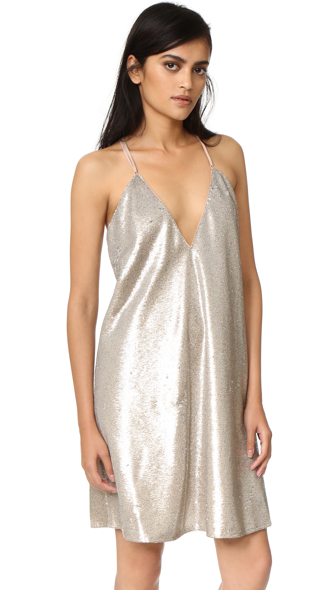 Shimmering sequins lend glamour to a shoulder baring The Jetset Diaries mini dress. Slim, adjustable straps cut across the low cut back. Lined. Fabric: Sequined mesh. 100% polyester. Hand wash. Imported, China. Measurements Length: 33.75in / 86cm, from
