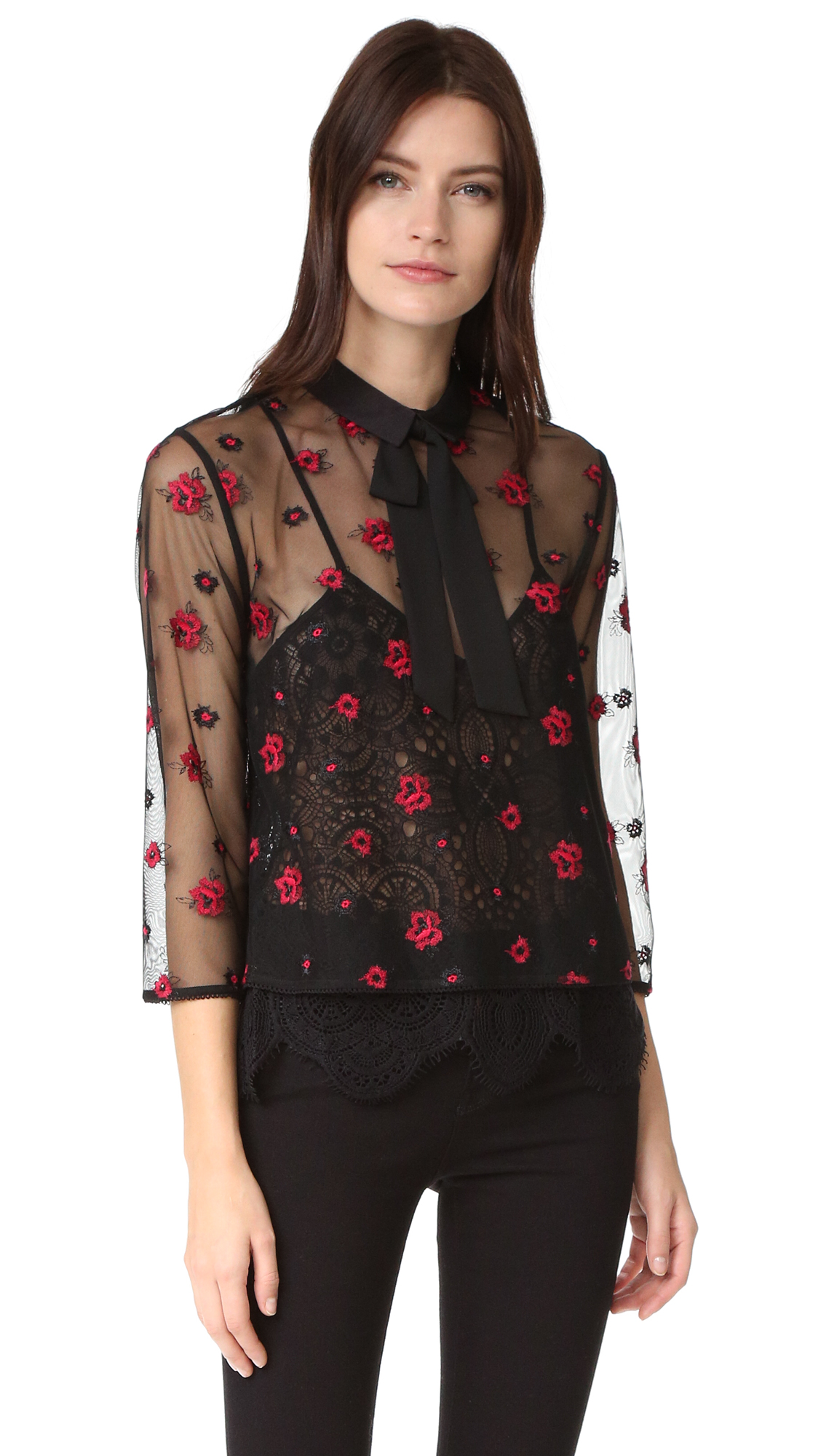 Bold floral embroidery details this delicate mesh The Kooples blouse. A fixed bow details the structured fold over collar. Optional lace camisole lining. 3/4 sleeves. Hidden back zip. Sheer. Fabric: Mesh. Shell: 100% polyester. Lining: 65% cotton/35% polyamide. Dry