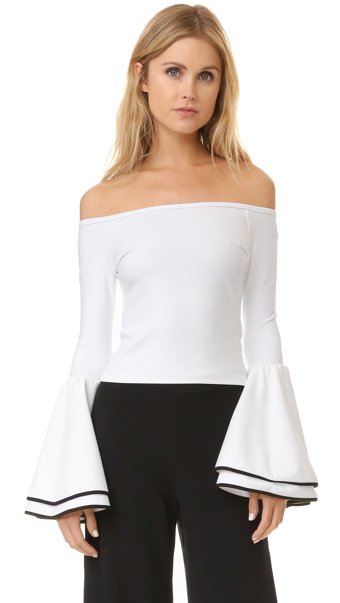 Contrast trim accents the layered bell sleeves on this Torn by Ronny Kobo crop top. Off shoulder neckline. Fabric: Ponte jersey. 60% rayon/33% nylon/7% lycra spandex. Dry clean. Made in the USA. Measurements Length: 12.5in / 32cm, from