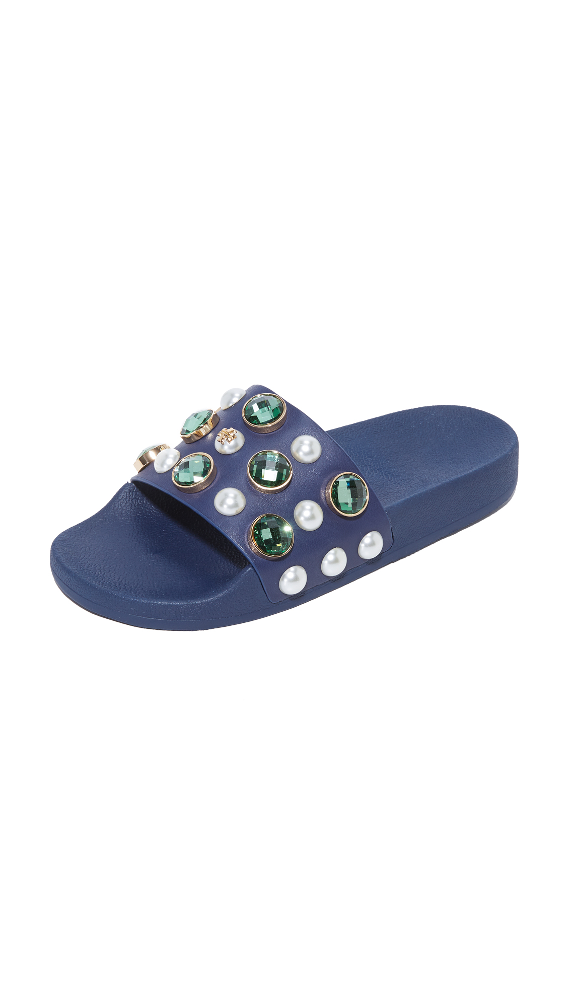 A leather upper with opulent crystals and imitation pearls brings an elevated look to these Tory Burch slides. Contoured insole. Rubber sole. Fabric: Rubber. Imported, China. This item cannot be gift boxed. Available sizes: 5,6,7,8,9,10,11