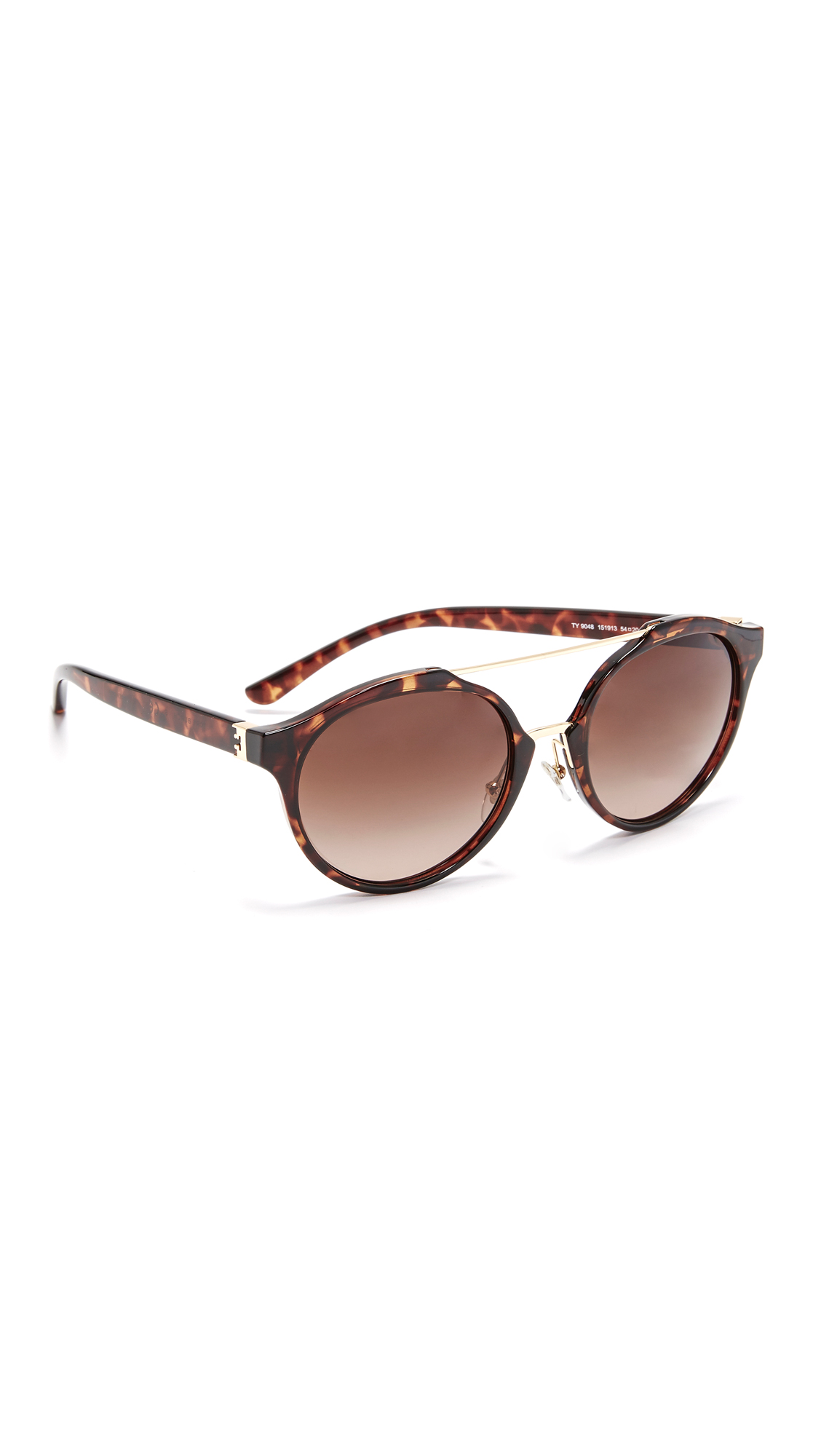 Modern Tory Burch aviator sunglasses with tortoiseshell frames and polished bars at the bridge. Adjustable silicone nose pads. Case and cleaning cloth included. Aviator frame. Non polarized lenses. Imported, China. Measurements Width: 6in / 15cm Height: 2.25in / 5.5