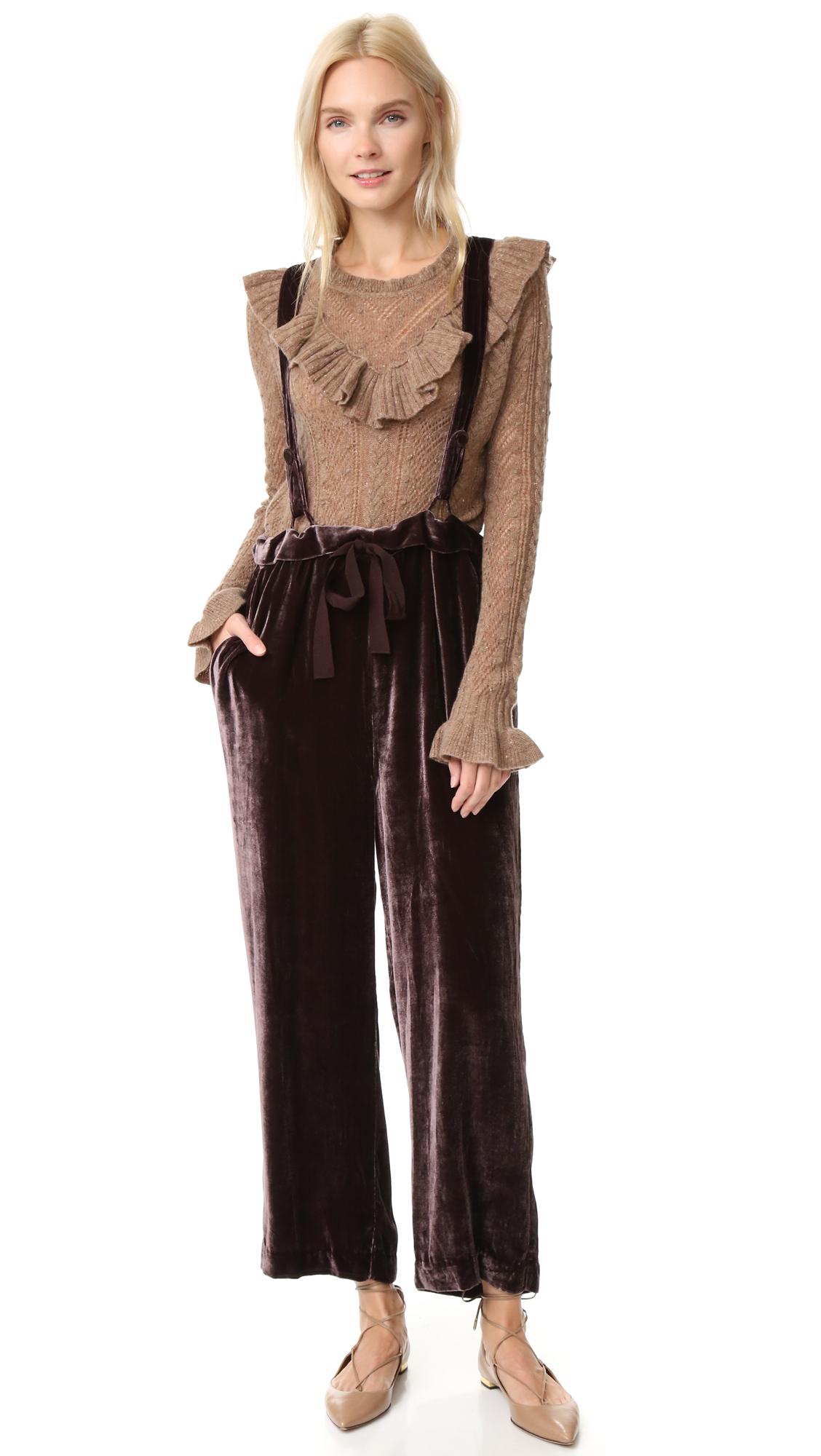 Slouchy Ulla Johnson overalls in soft velvet. Slant hip pockets. Adjustable crossover shoulder straps. Fabric: Velvet. 82% viscose/18% silk. Dry clean. Imported, India. Measurements Inseam: 24.5in / 62cm Leg opening: 20.5in / 52cm Measurements from size 4. Available sizes: 4