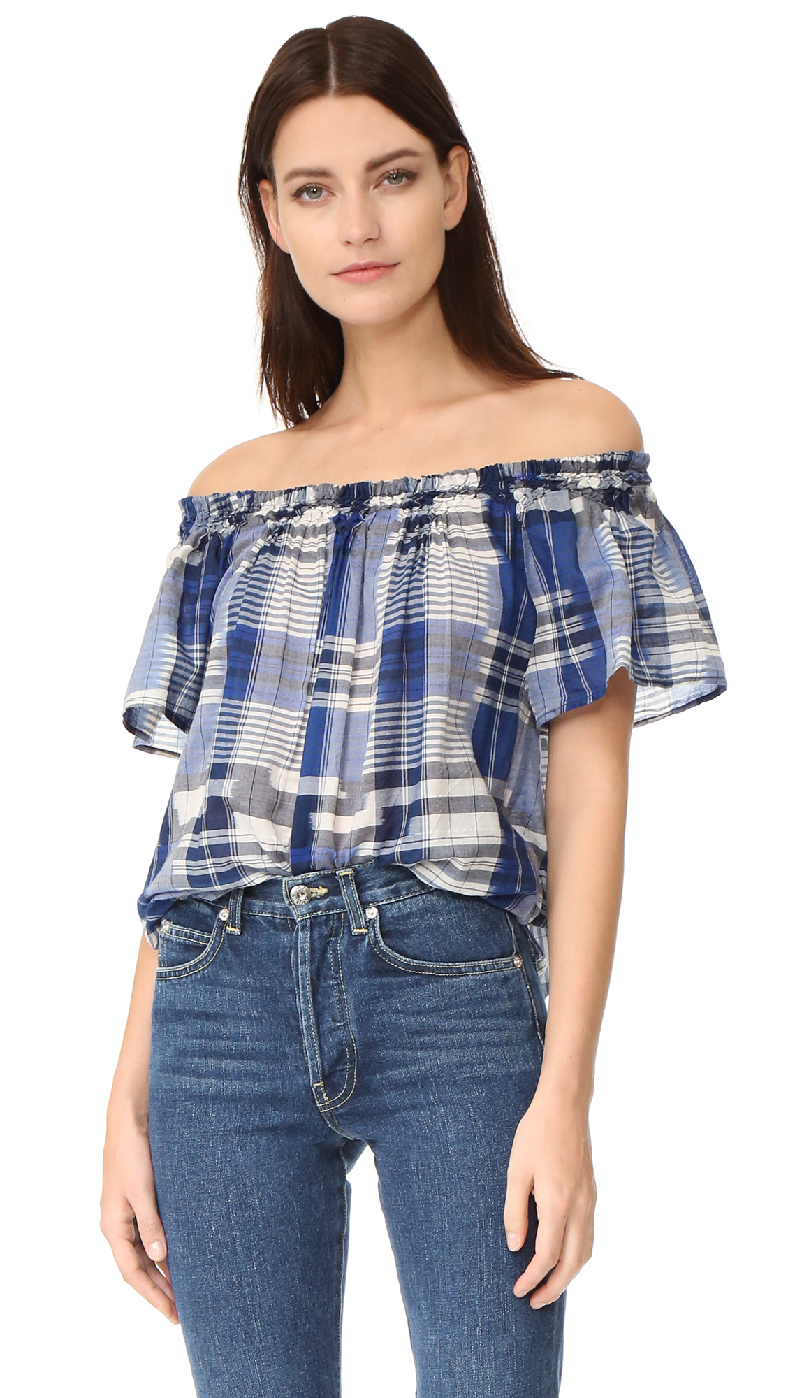 Ikat stripes accent this faded Ulla Johnson blouse. Lattice smocking traces the off shoulder neckline. Short sleeves. Fabric: Soft shirting. 100% cotton. Hand wash. Imported, India. Measurements Length: 22.75in / 58cm, from shoulder Measurements from size 4. Available sizes: 0,2,4,6,10