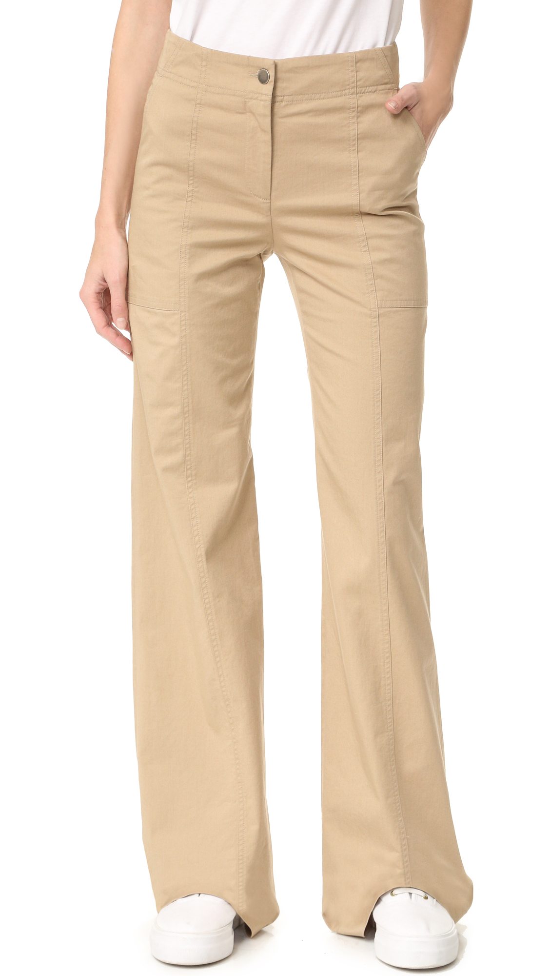 Crisp Veronica Beard pants with a high waisted, wide leg profile. Slant front pockets and button flap back pockets. Button closure and zip fly. Fabric: Stretch twill. 97% cotton/3% elastane. Dry clean. Made in the USA. Measurements