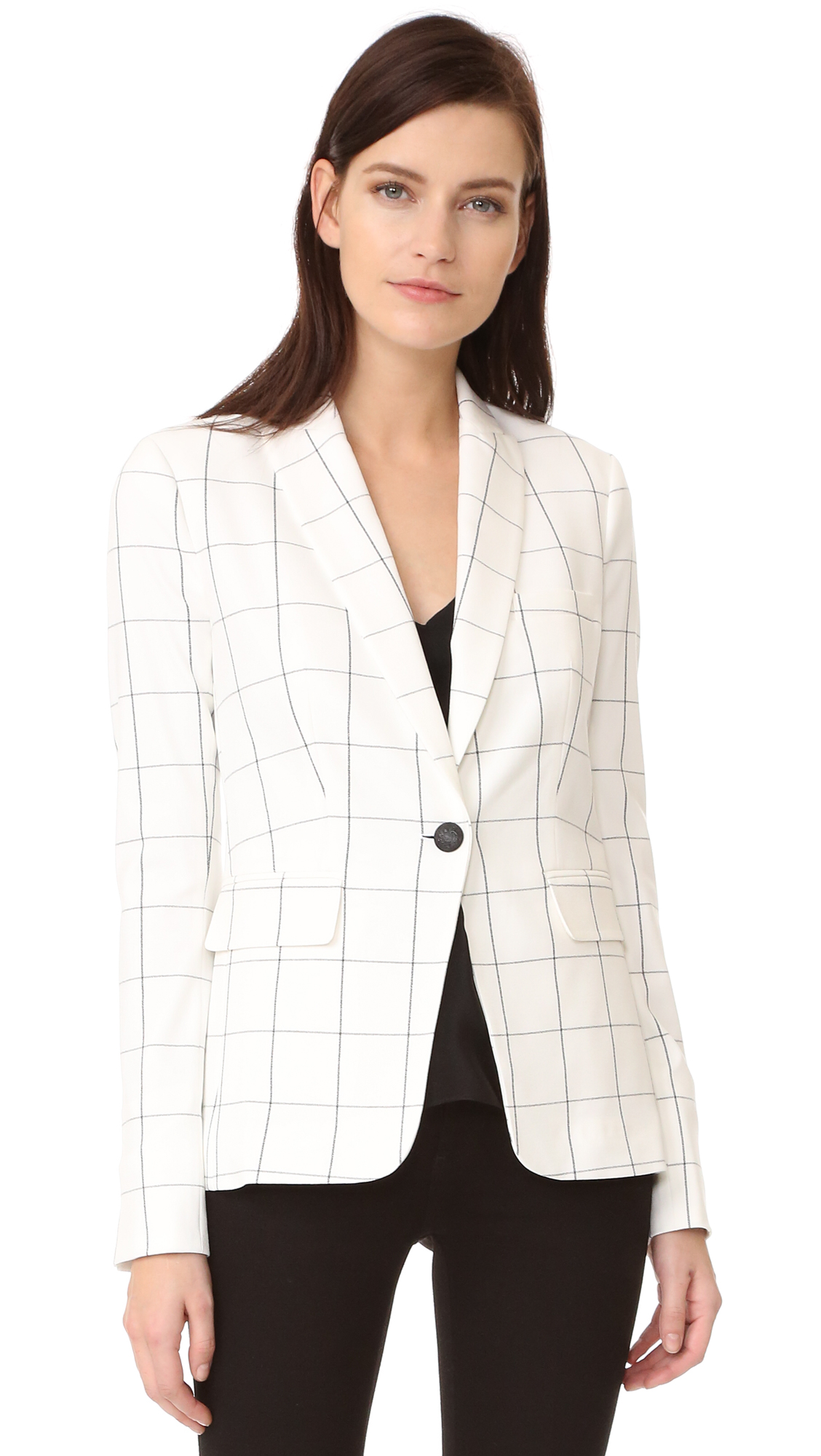 Windowpane checks bring sophisticated style to this tailored Veronica Beard blazer. Padding structures the shoulders, and a vent opens the back. Notched lapels and single button placket. 3 pockets. Long sleeves. Lined. Fabric: Crepe suiting. 68% polyester/28% viscose/3%