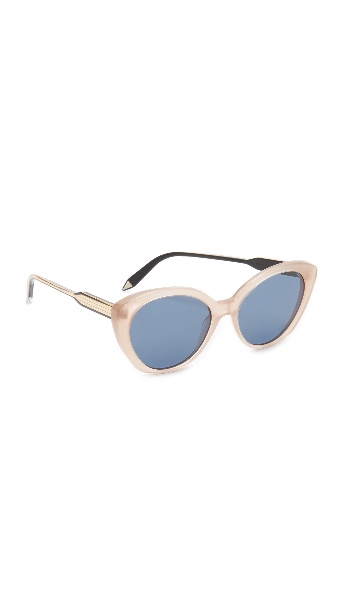 Glossy acetate Victoria Beckham sunglasses styled with metallic accents the arms. Hard case and cleaning cloth included. Cateye frame. Non polarized lenses. Made in Italy. Measurements Width: 5.75in / 14.5cm Height: 2.25in / 5.5cm Lens Width: 52mm. Available