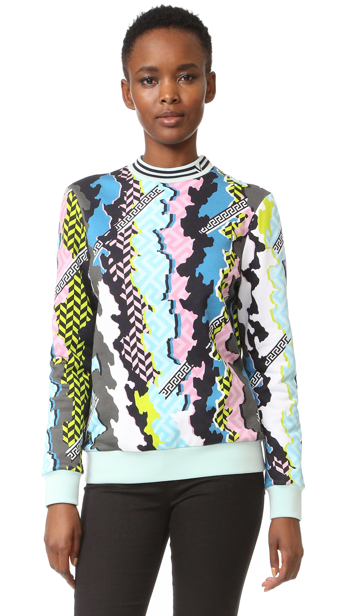 A Versace sweatshirt in a vivid print. Snug, ribbed edges. Long sleeves. Fabric: Fleece. 100% cotton. Dry clean. Made in Italy. Measurements Length: 24.5in / 62cm, from shoulder Measurements from size 40. Available sizes: 42,44