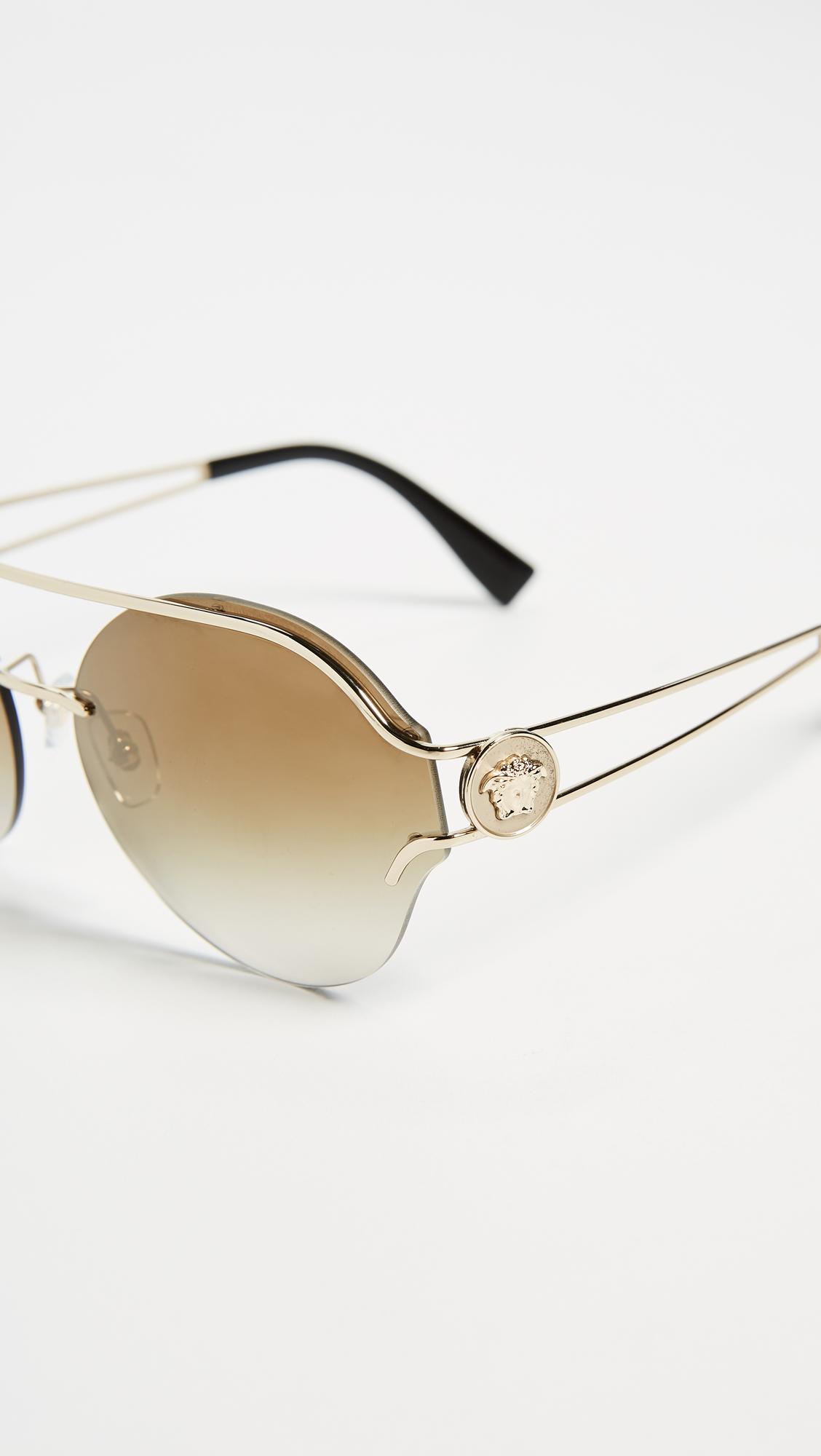 5b28604248c058 Versace VE2184 Medusa Visor Round Sunglasses