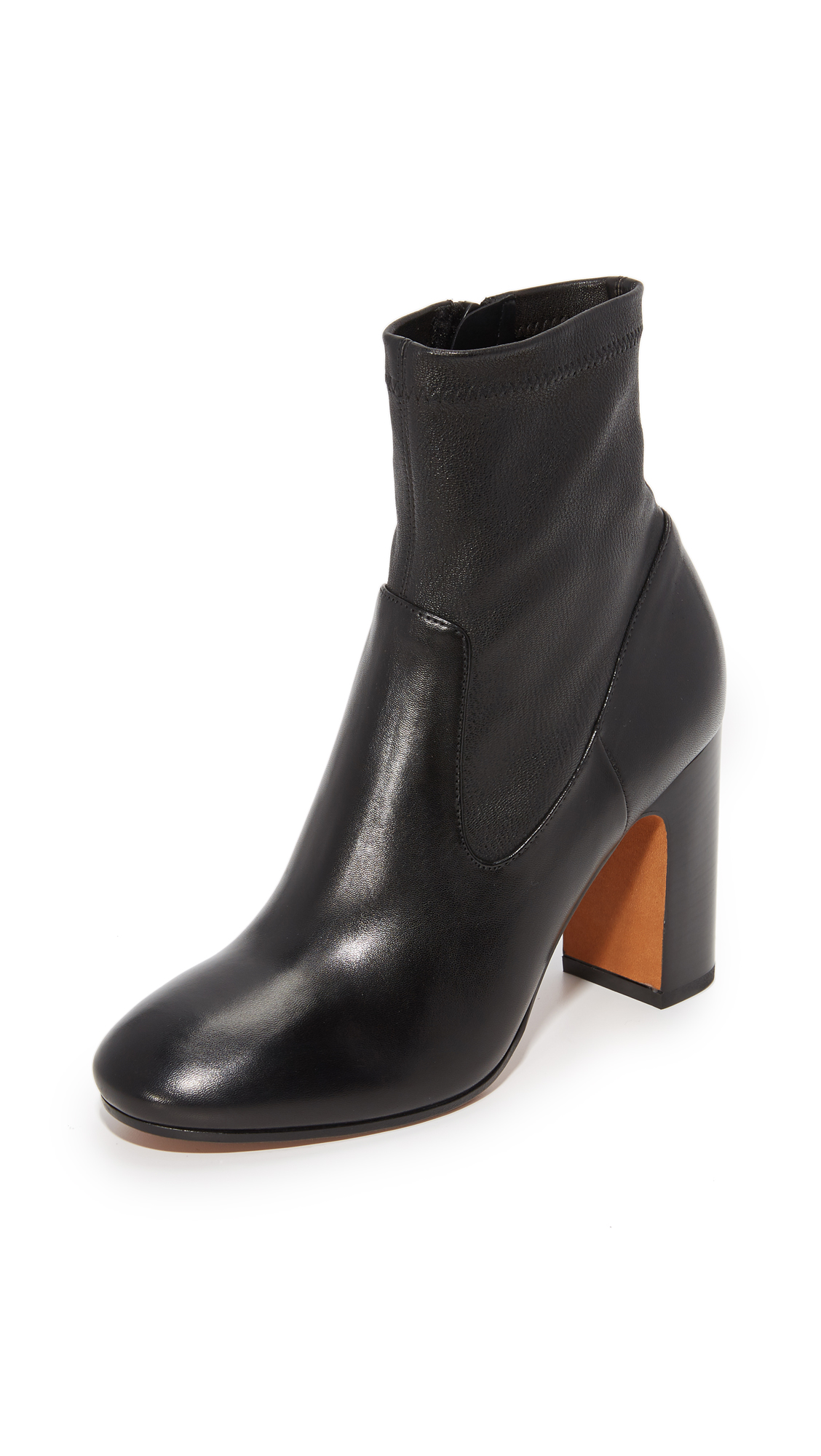 Refined Vince booties with a tonal shaft of stretch leather. Exposed side zip. Sculpted, stacked heel and leather sole. Leather: Cowhide. Made in Italy. This item cannot be gift boxed. Measurements Heel: 3.25in / 85mm. Available sizes: 5.5