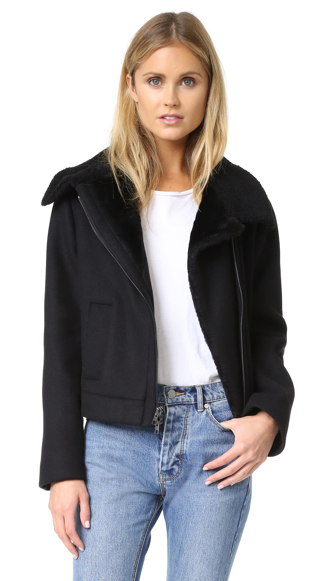 Tonal shearling trims the collar, placket, and pockets on this cozy Vince moto jacket. 2 way zip closure. Long sleeves. Lined. Fur: Dyed lamb shearling, from Spain. Fabric: Felt. Shell: 70% wool/20% polyamide/10% cashmere. Lining: 100% polyester. Dry clean.