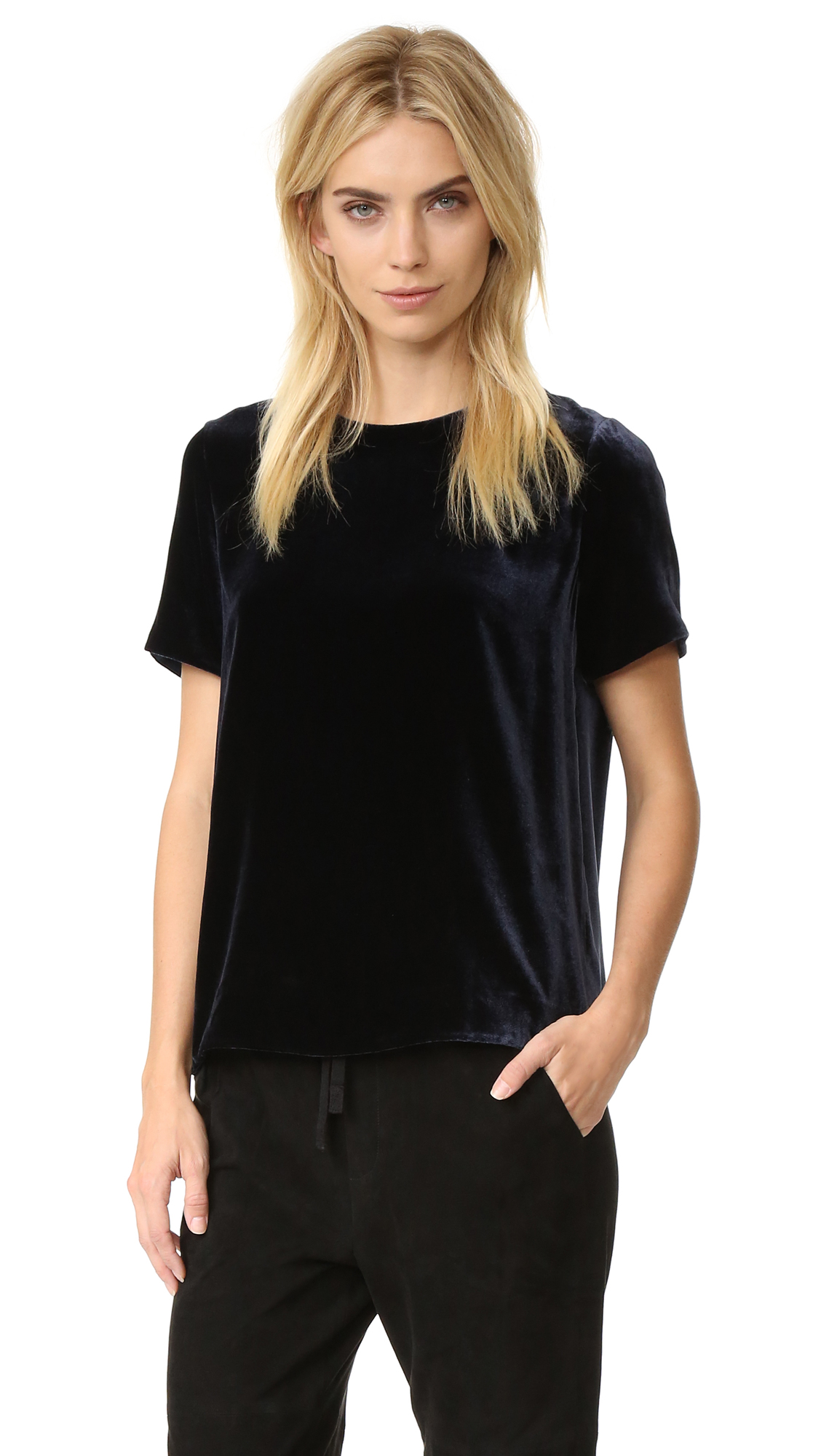 A crew neck Vince tee rendered in shimmering silk blend velvet. Hook and eye closures at the back placket. Short sleeves. Fabric: Velvet. 80% viscose/20% silk. Dry clean. Imported, China. Measurements Length: 24.5in / 62cm, from shoulder Measurements