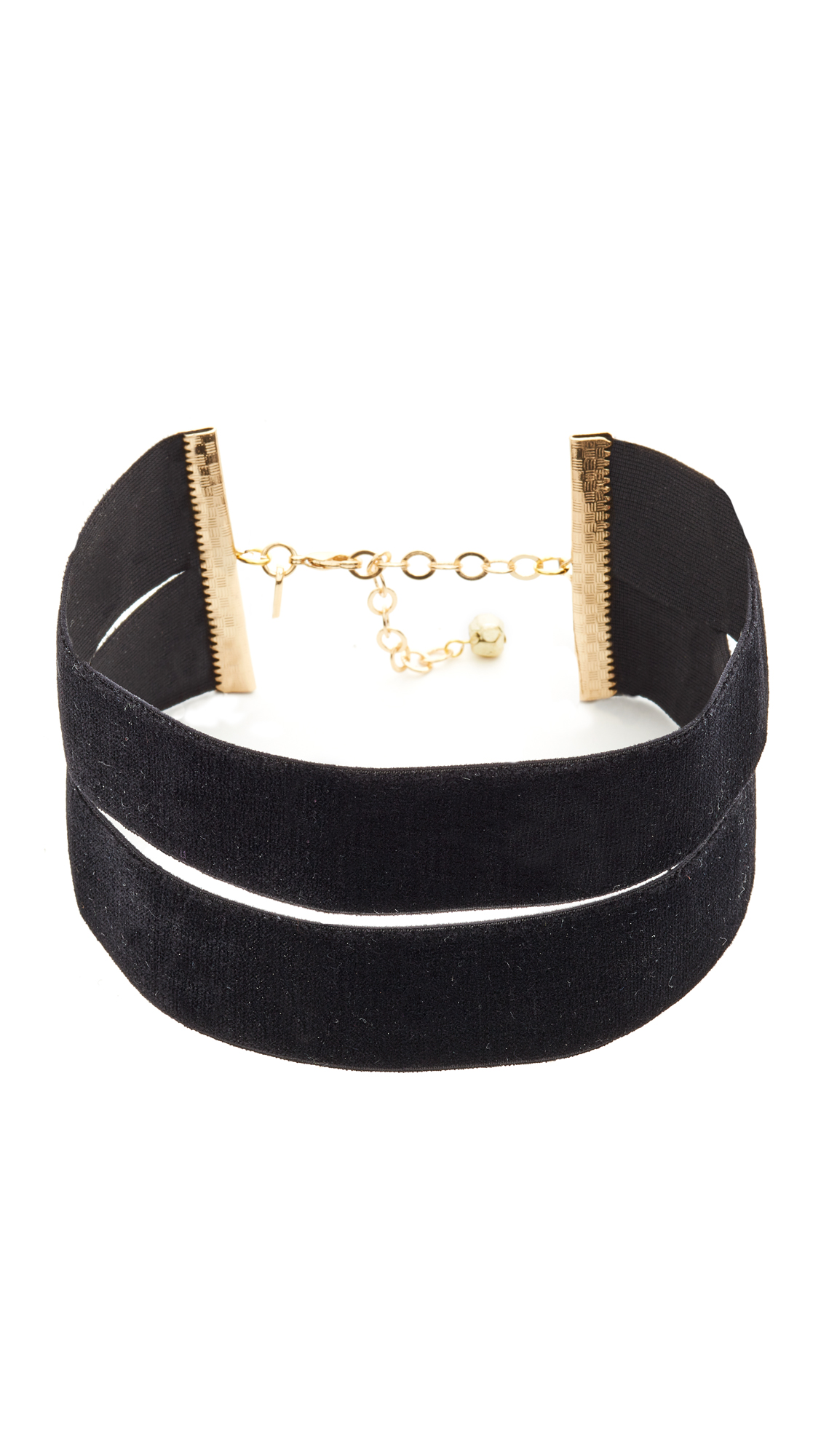 A wide, double strap Vanessa Mooney choker made from luxe velvet. Adjustable length. Lobster claw clasp. Made in the USA. Measurements Width: 2in / 5cm Length: 12 14in / 30.5 35.5cm. Available sizes: One Size