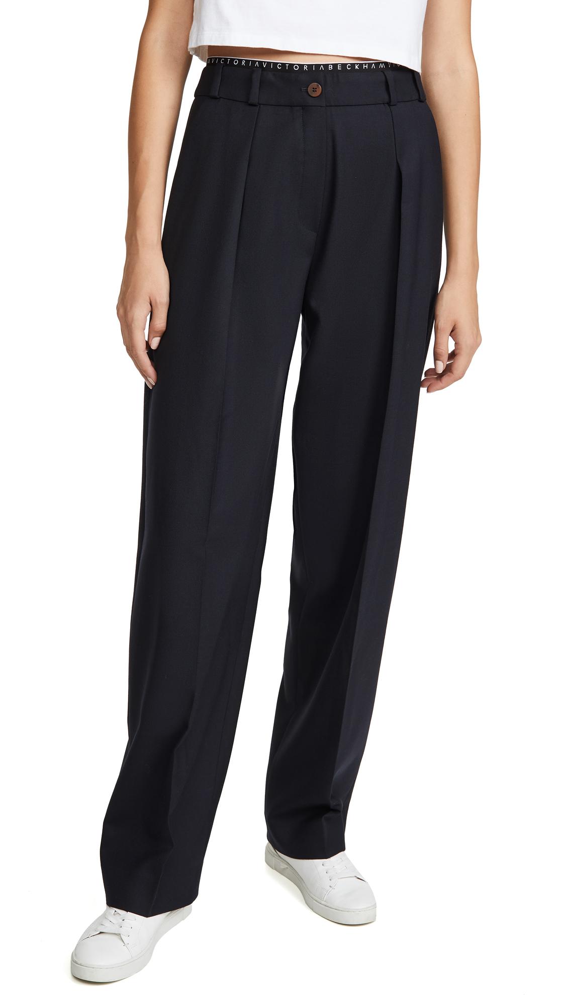 Buy Victoria Victoria Beckham online - photo of Victoria Victoria Beckham Logo Detail Trousers