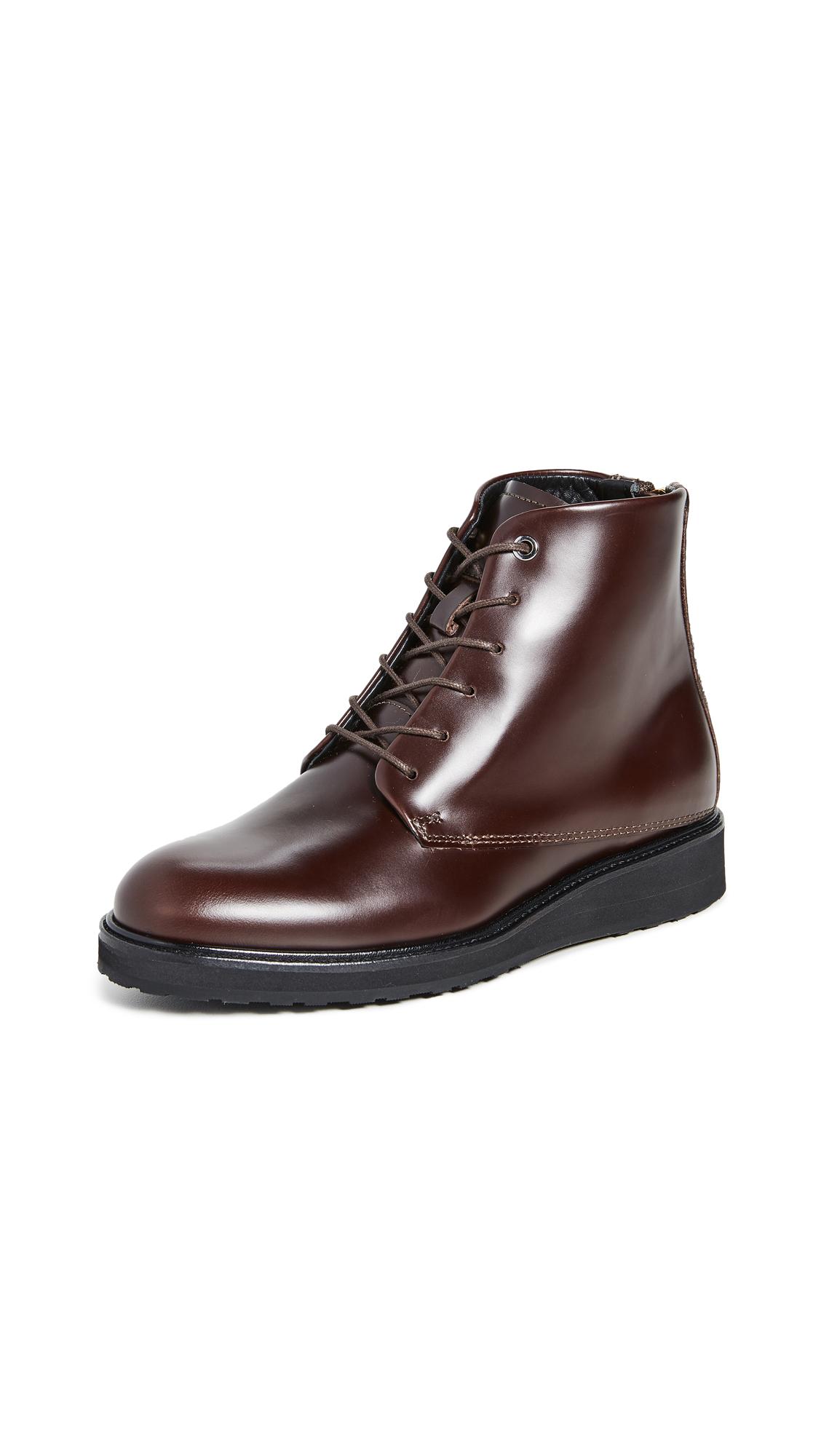 Buy WANT Les Essentiels online - photo of WANT Les Essentiels Menara High Wedge Derby Boots