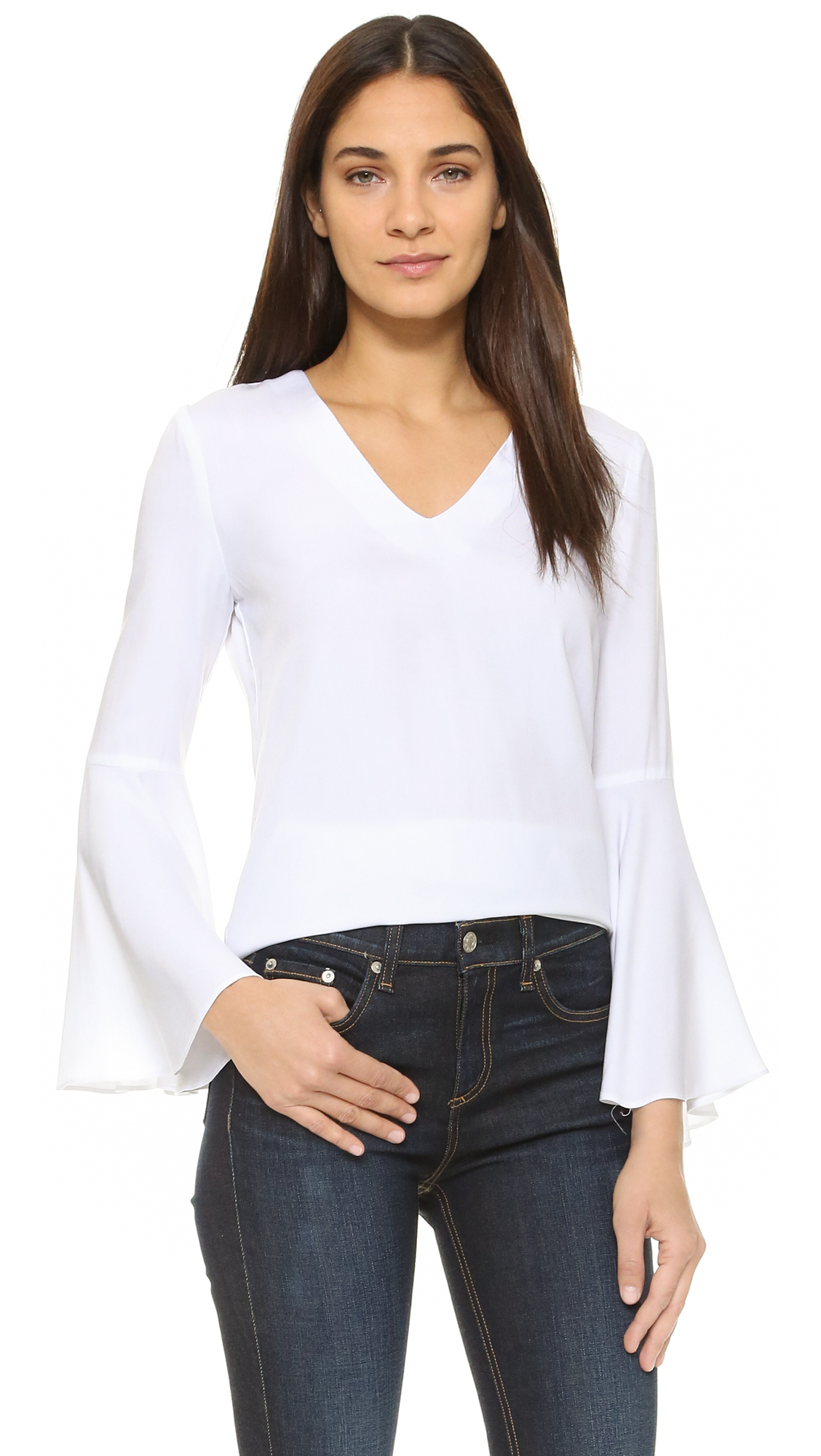 Long, fitted sleeves flare into flounced ruffle cuffs on this simple, yet dynamic WAYF blouse. V neckline. Curved hem. Fabric: Lightweight weave. 100% rayon. Dry clean. Made in the USA. Imported materials. Measurements Length: 27.25in / 69cm, from