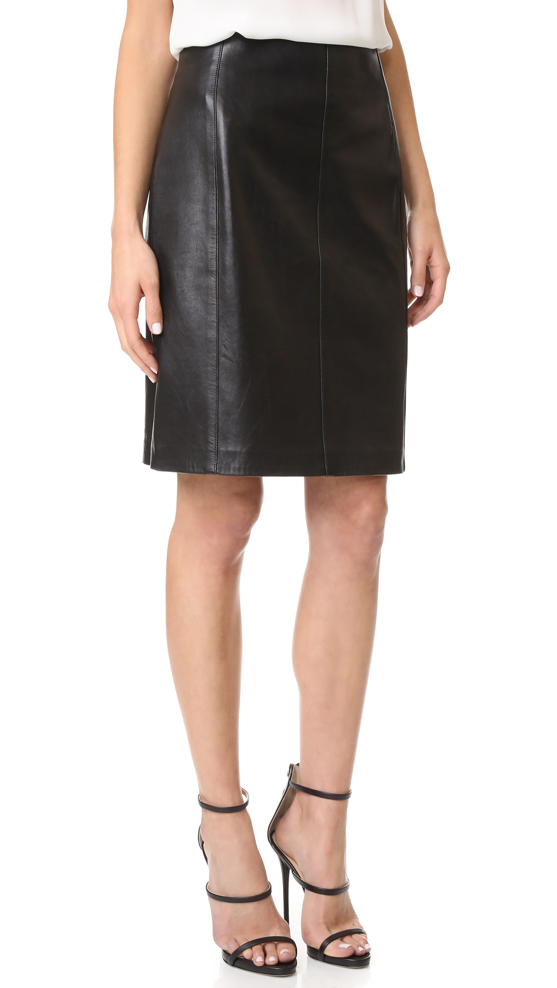 A previously owned Alaia leather skirt with a classic A line profile. Exposed zips create edgy slits in back. Lined. Fabric: Leather. Leather: 100% lambskin. Leather clean. Made in France. NOTE: Gentle wear should be expected and