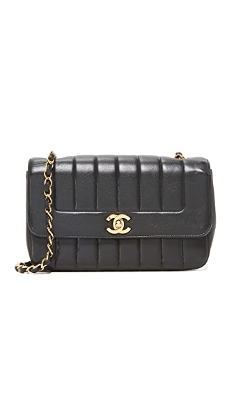 What Goes Around Comes Around Chanel Vertical Flap Bag (Previously Owned) - Black